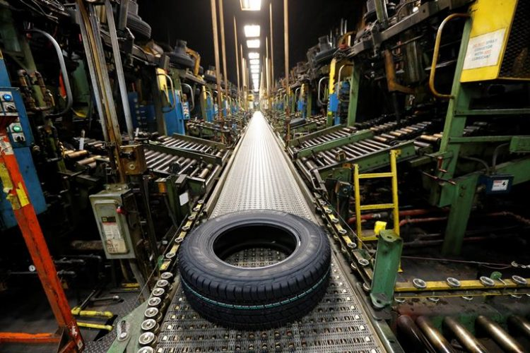 A new Falken tire comes off the curing line at the Sumitomo Rubber USA tire manufacturing plant in Tonawanda last November.  (Derek Gee/Buffalo News file photo)