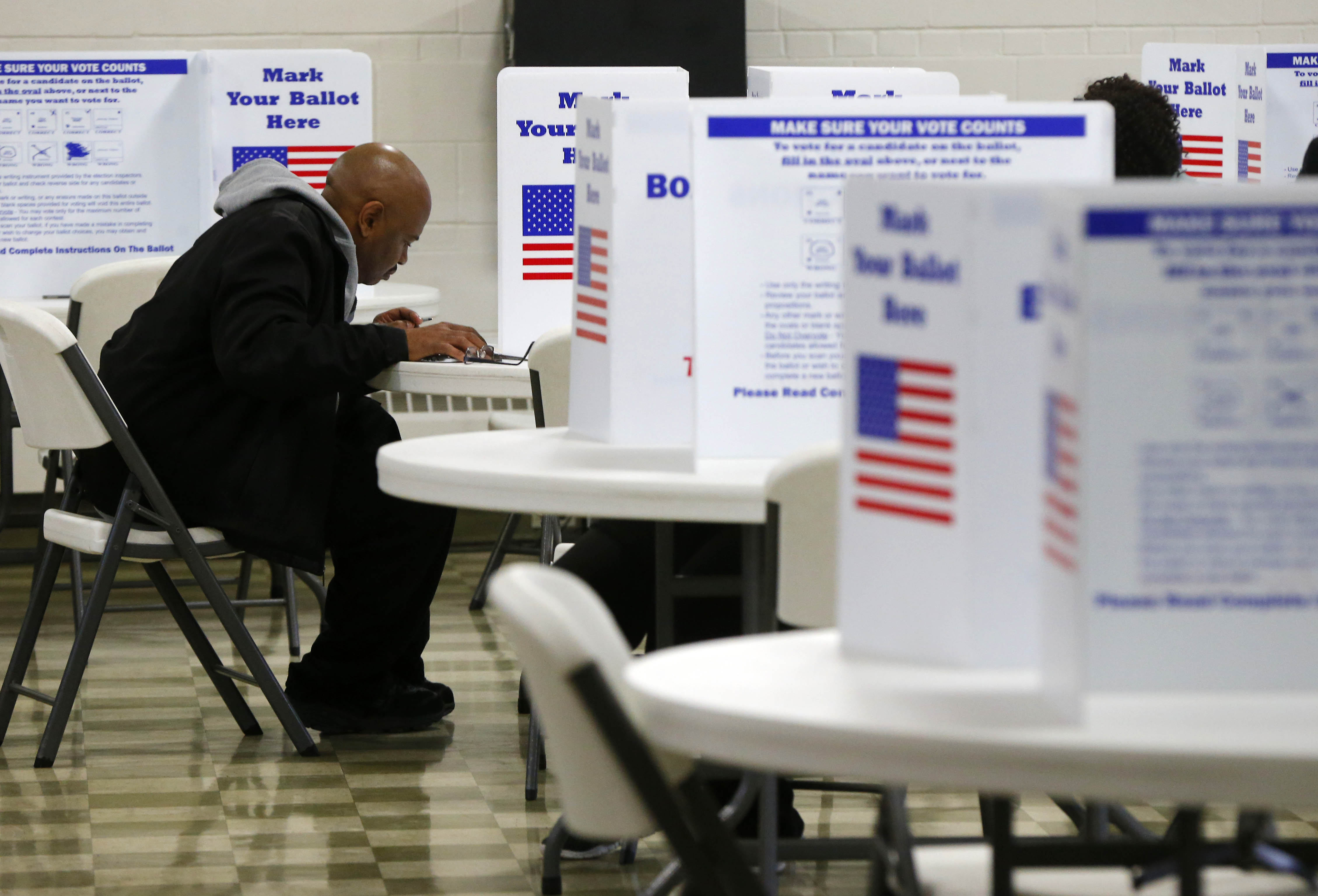 Darryl Carmichael cast his vote at the New Covenant United Church of Christ in Buffalo on Nov. 8. (Mark Mulville/News file photo)