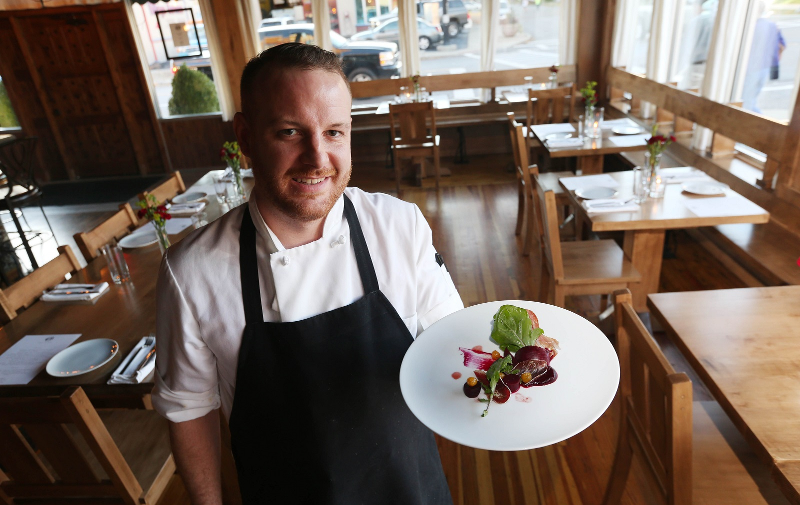 Carte Blanche owner and chef Andrew Murtha presents the beet salad. (Sharon Cantillon/Buffalo News)