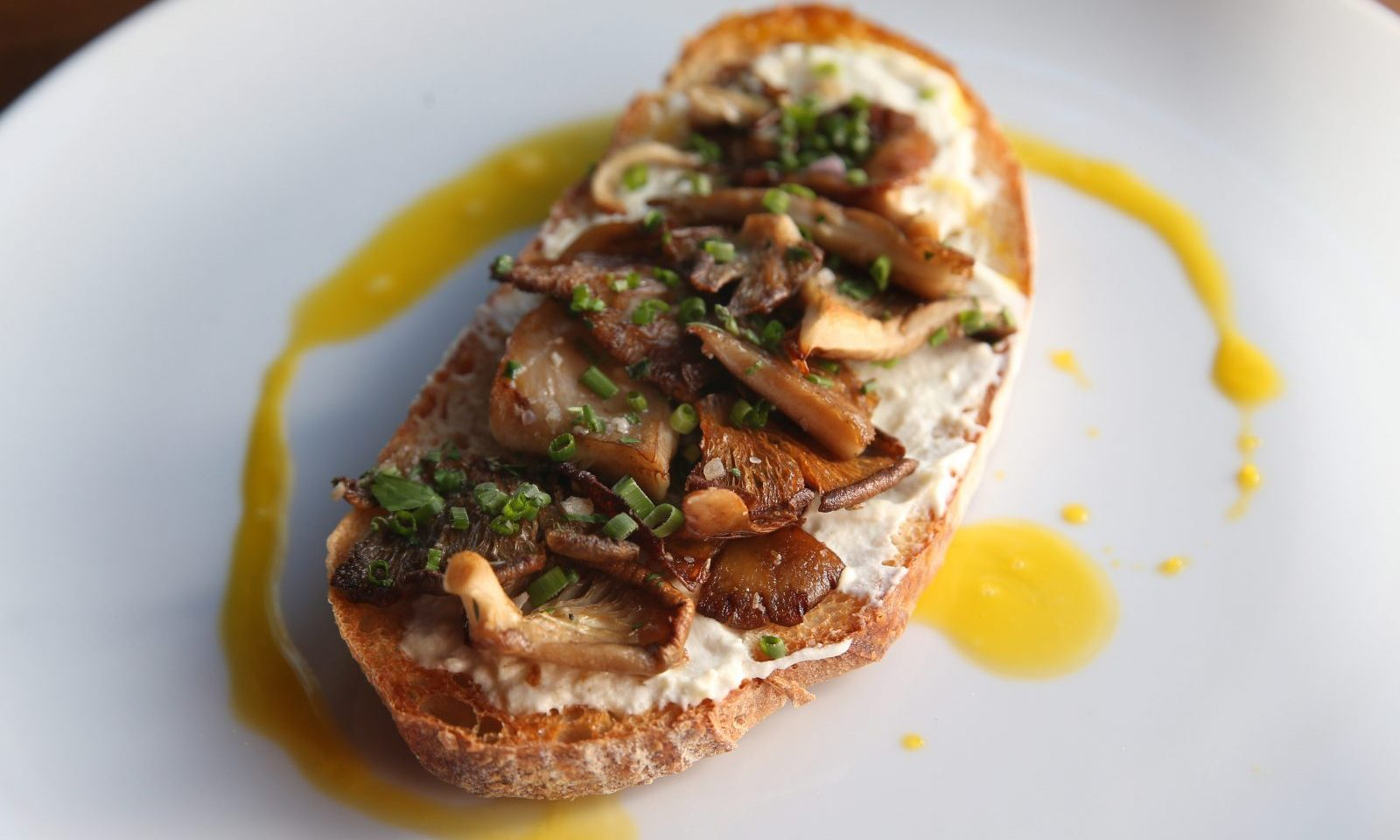 The Flat 12 mushroom toast is made with goat cheese and egg yolk at Carte Blanche. (Sharon Cantillon/Buffalo News)