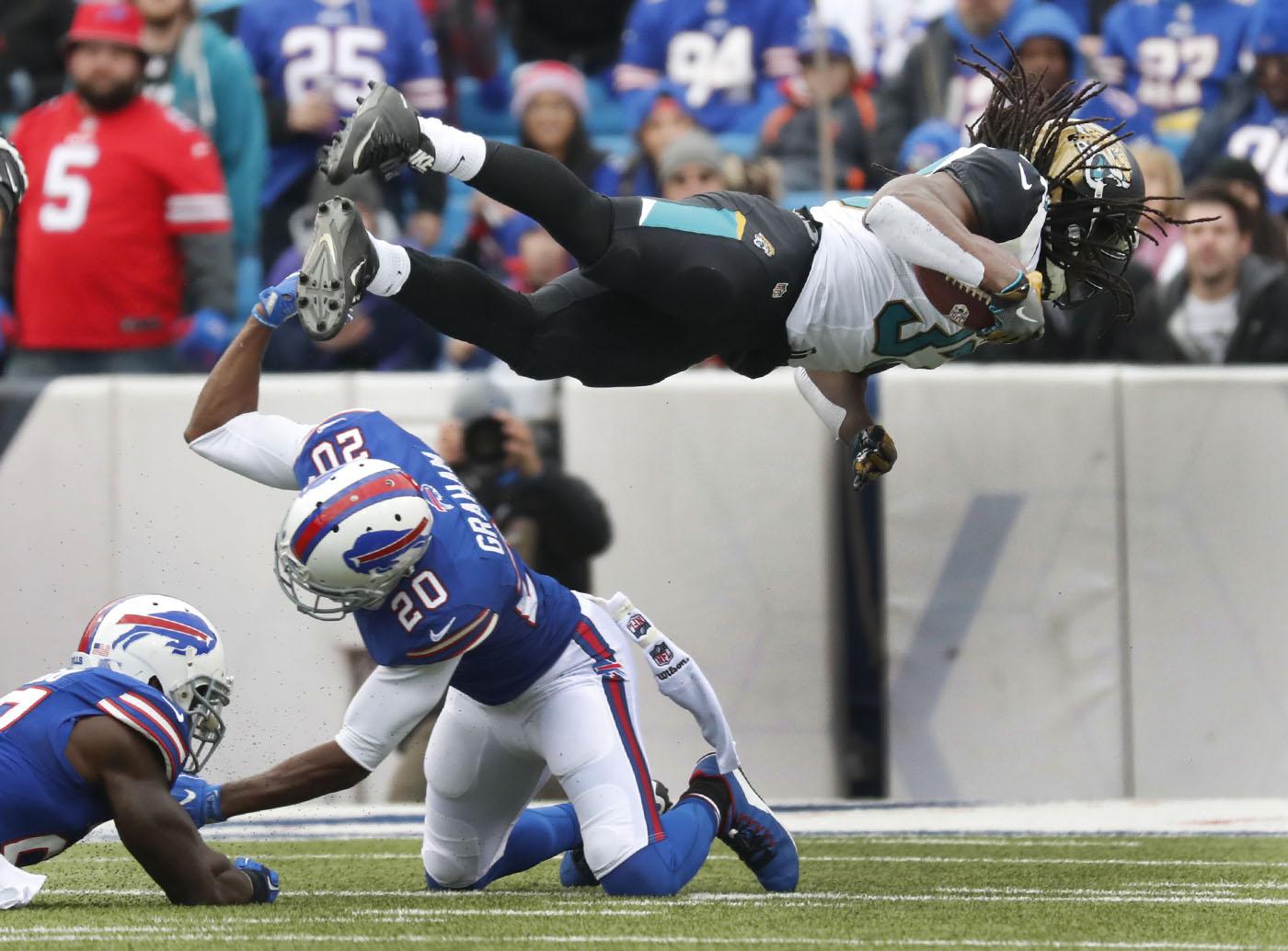 Buffalo Bills Corey Graham cannot tackle Jacksonville Jaguars Chris Ivory during first quarter action at New Era Field on Sunday, Nov. 27, 2016.(Harry Scull Jr./Buffalo News)