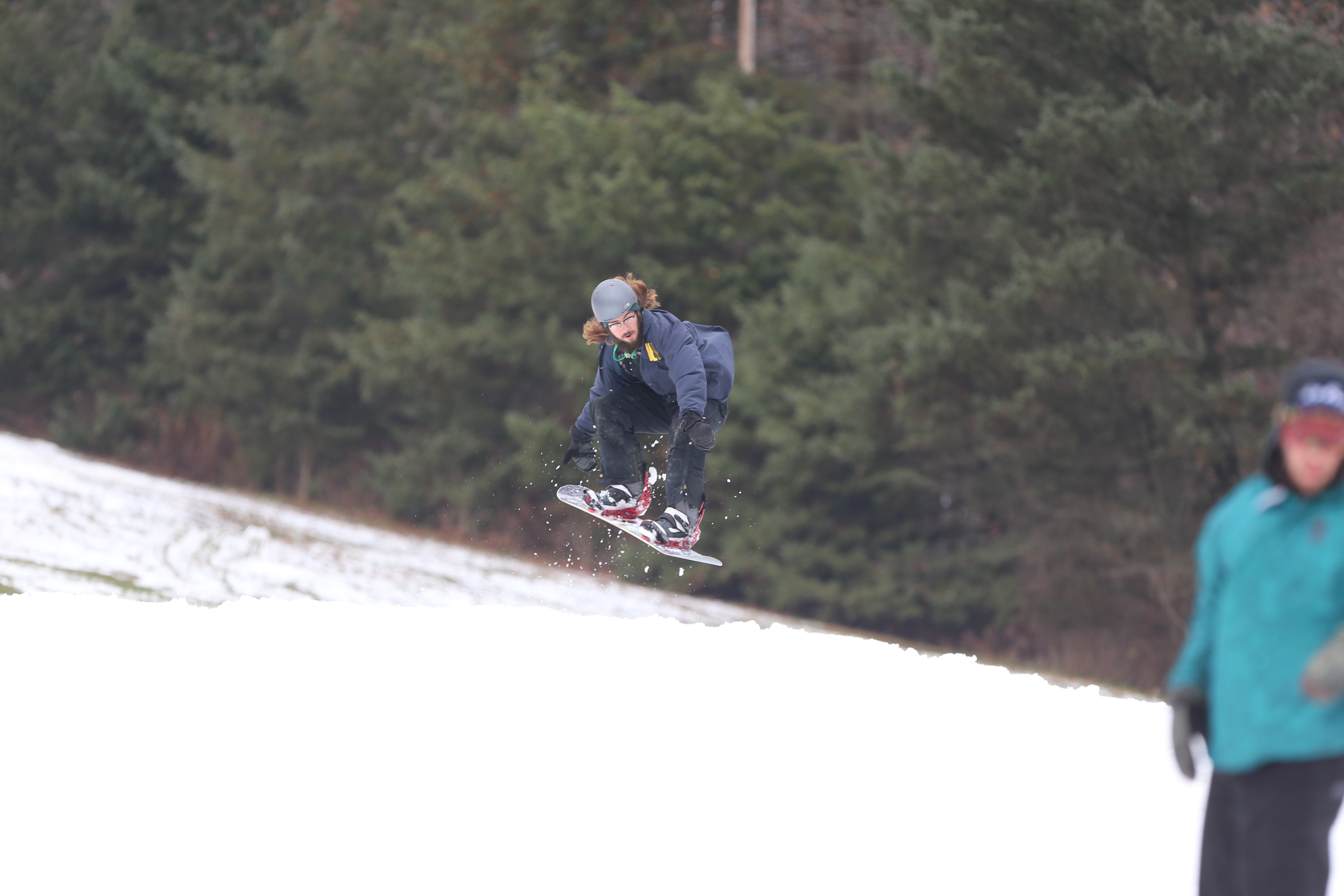 Snowboarder Steve Polanowski, of Lancaster hits a jump on Mardi Gras as snowboarders and skiers hit the Holiday Valley slopes on opening weekend in November. (John Hickey/Buffalo News)