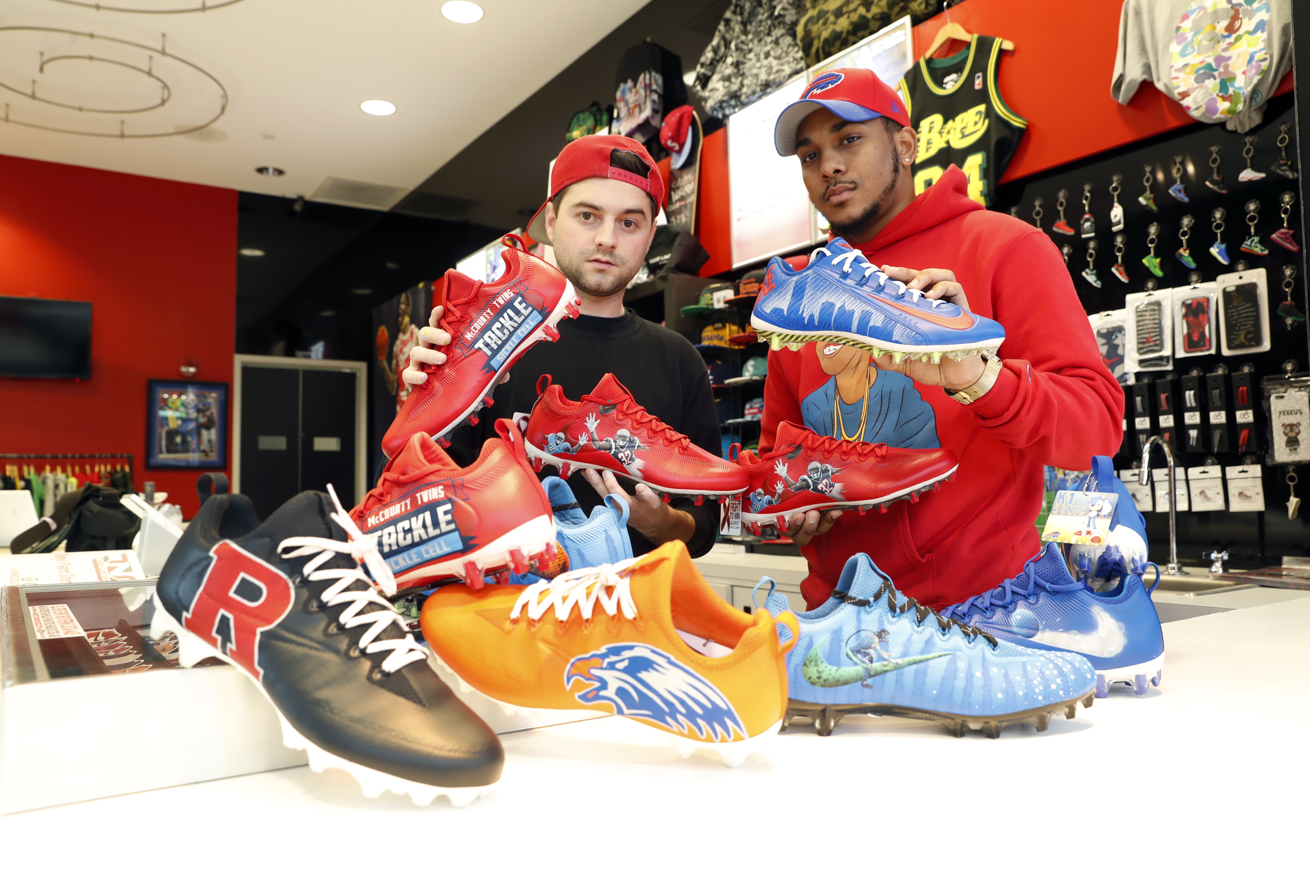 Nicholas Avery, left, and Napoleon 'Polo' Kerber at Fabes Sole High in the Walden Galleria Mall with some of the NFL's 'My Cause, My Cleats.' (Harry Scull Jr./Buffalo News)