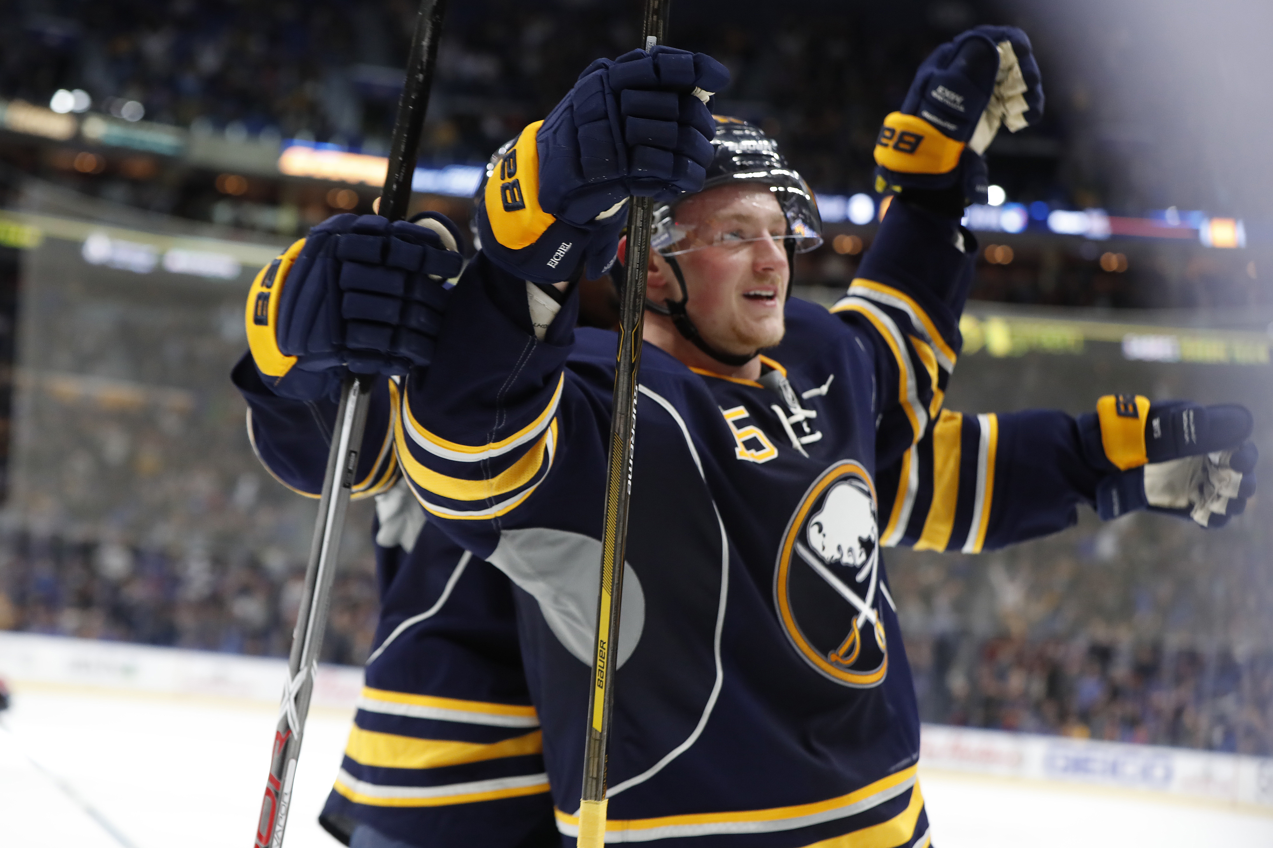 Jack Eichel celebrates the game-winning goal with Evander Kane (Harry Scull Jr./Buffalo News).