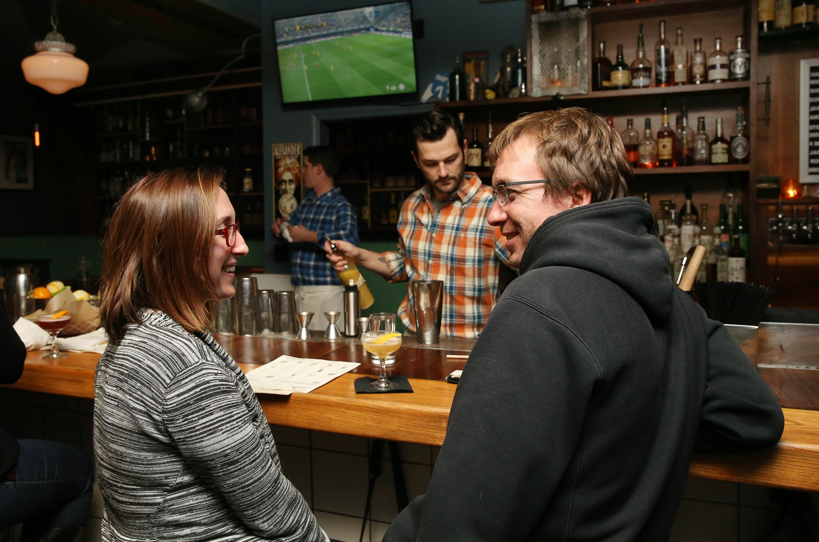 Sarah Quintal, left, and Scott Roche of Buffalo, hang out while a soccer game airs on the TVs at Ballyhoo. (Sharon Cantillon/Buffalo News)
