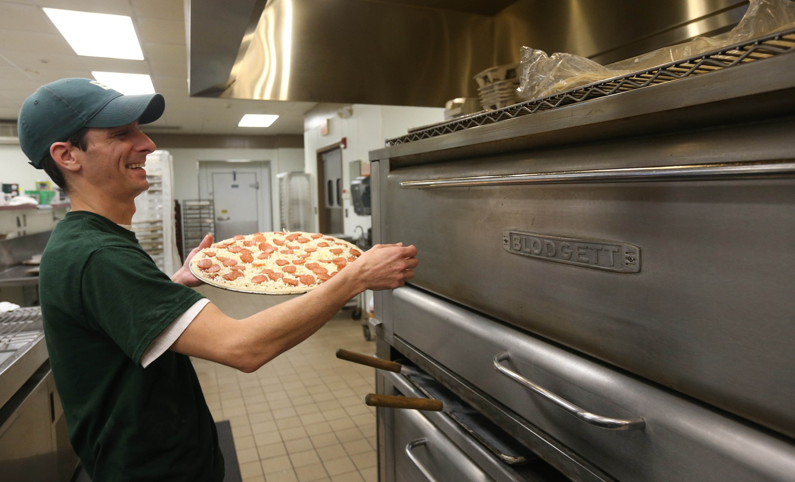 Manager Charlie Genco makes a cheese and pepperoni pizza. (Sharon Cantillon/Buffalo News)