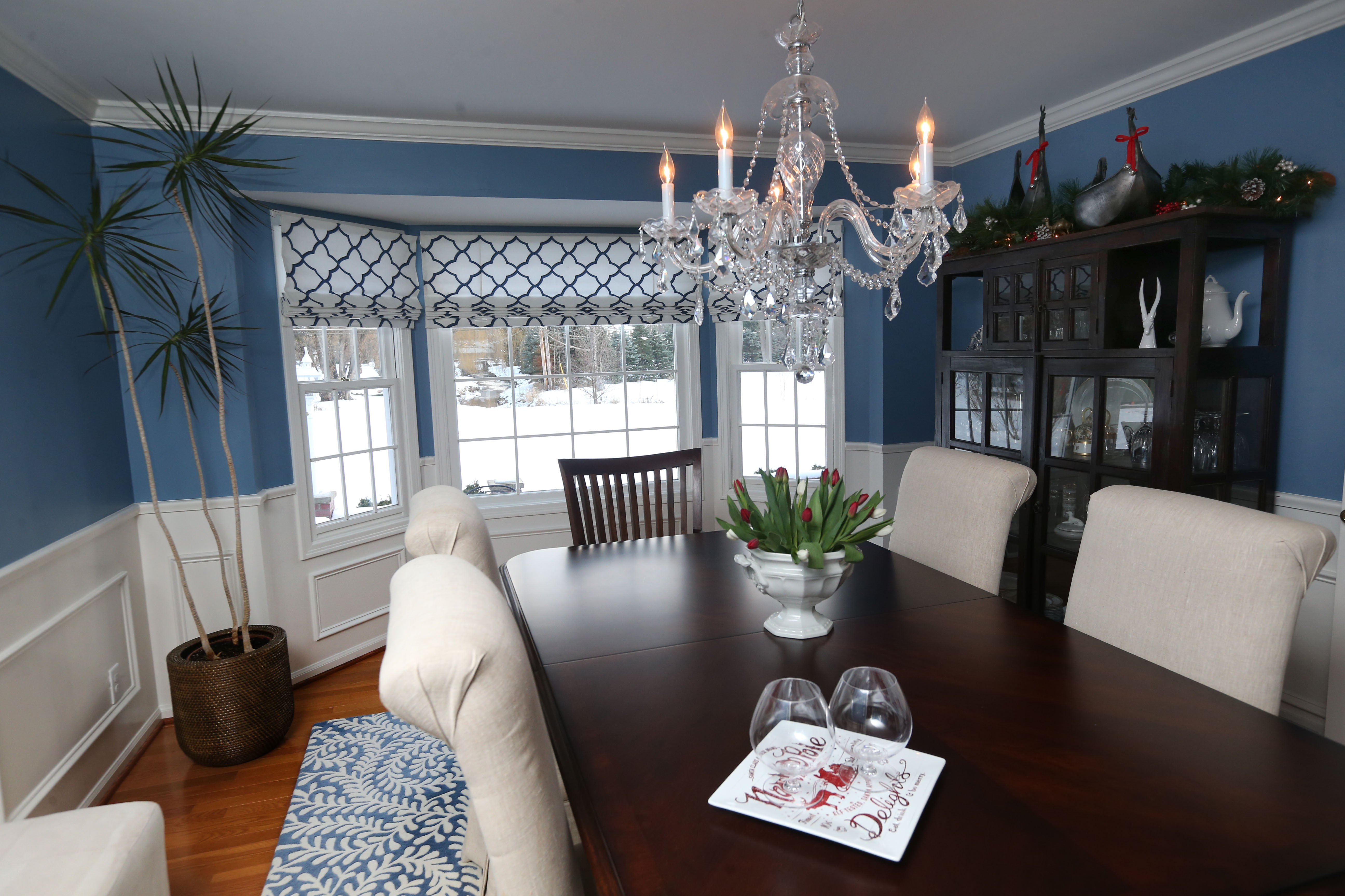 The dining room walls above the wainscoting are painted Benjamin Moore New York State of Mind. Photo by Sharon Cantillon/Buffalo News.