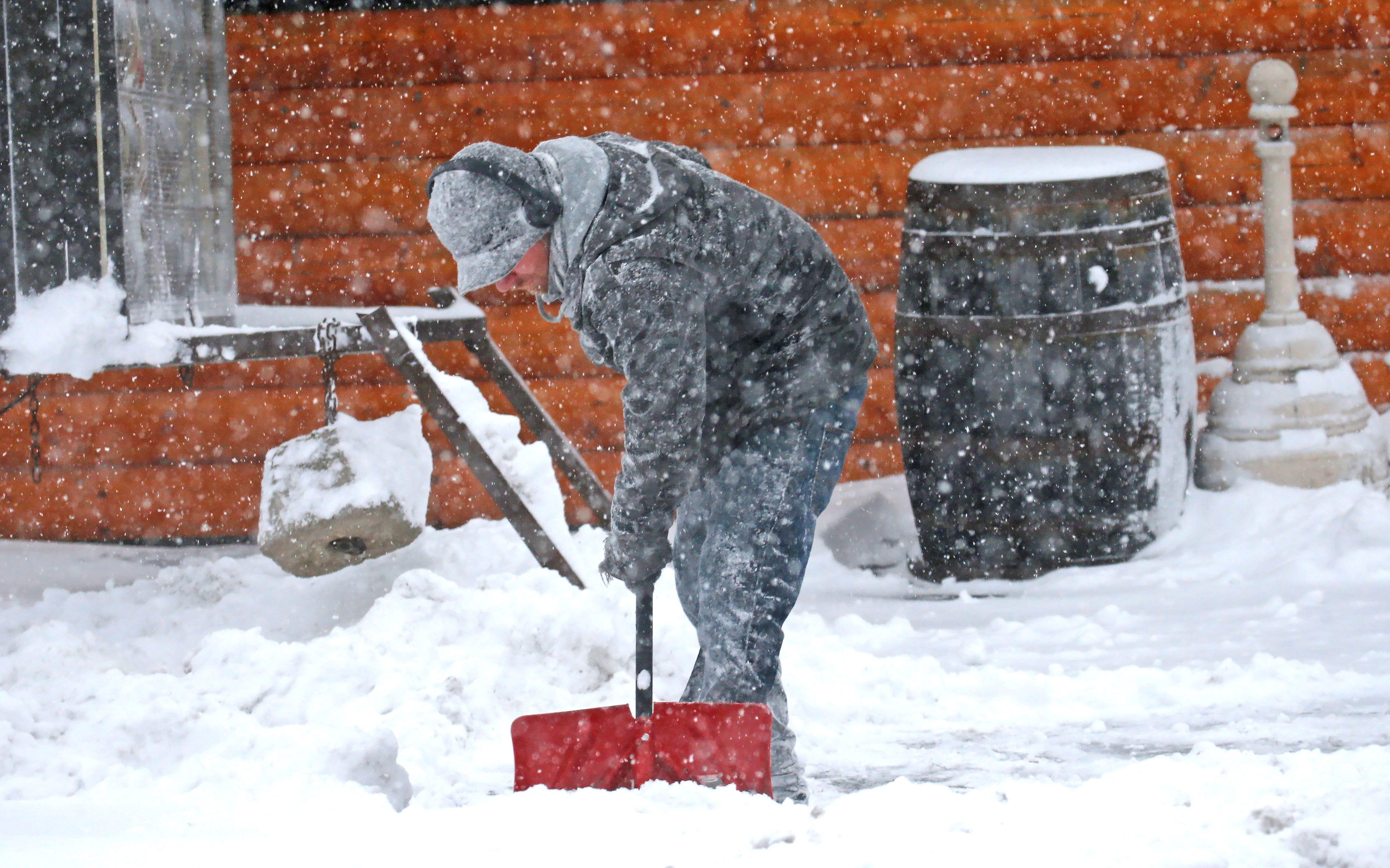 A man shovels in Cheektowaga on Wednesday, Dec. 14, 2016.  (Robert Kirkham/Buffalo News)