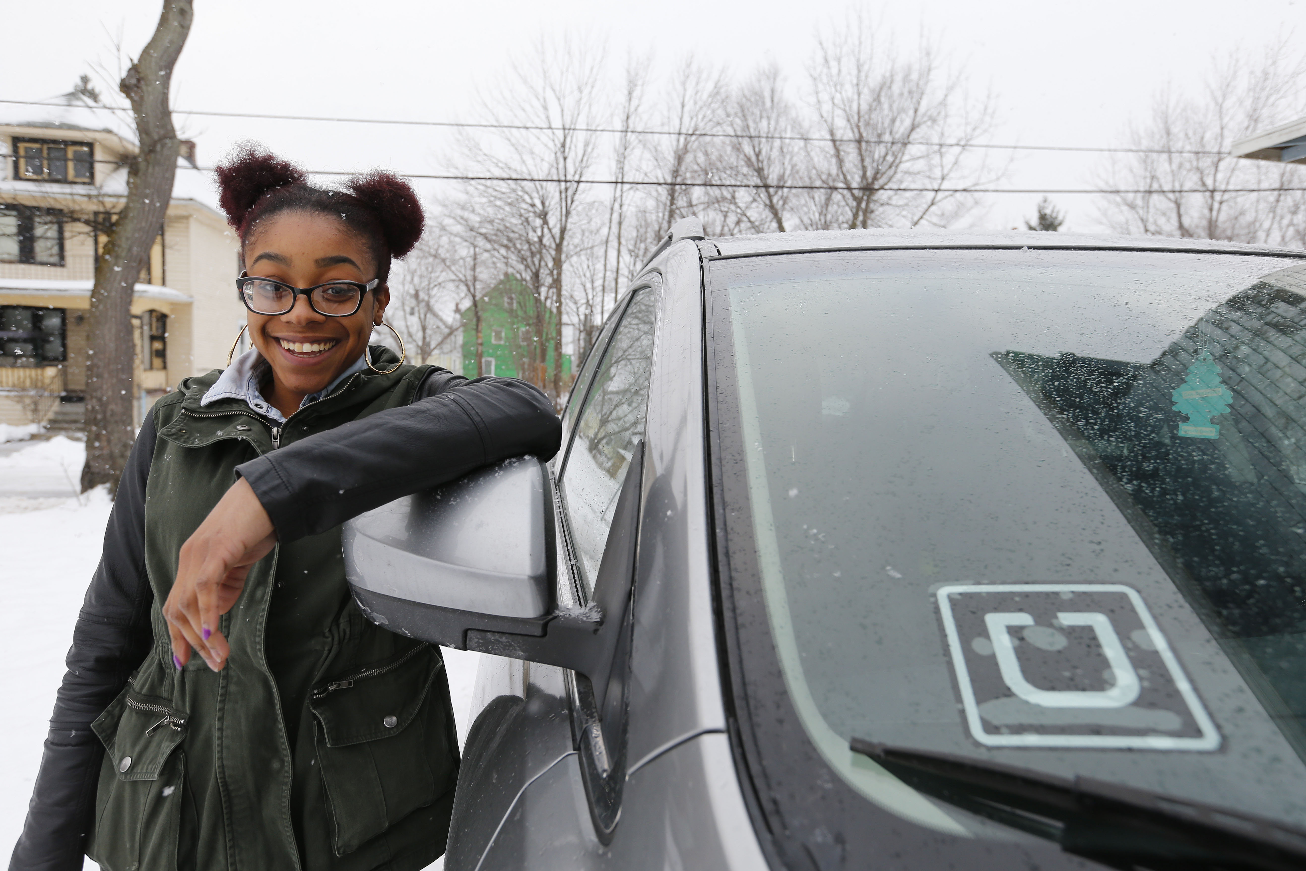 The Uber sticker on Ayanna Lofton's car at her home in Buffalo on Monday, Dec. 19, 2016.    (Mark Mulville/Buffalo News)