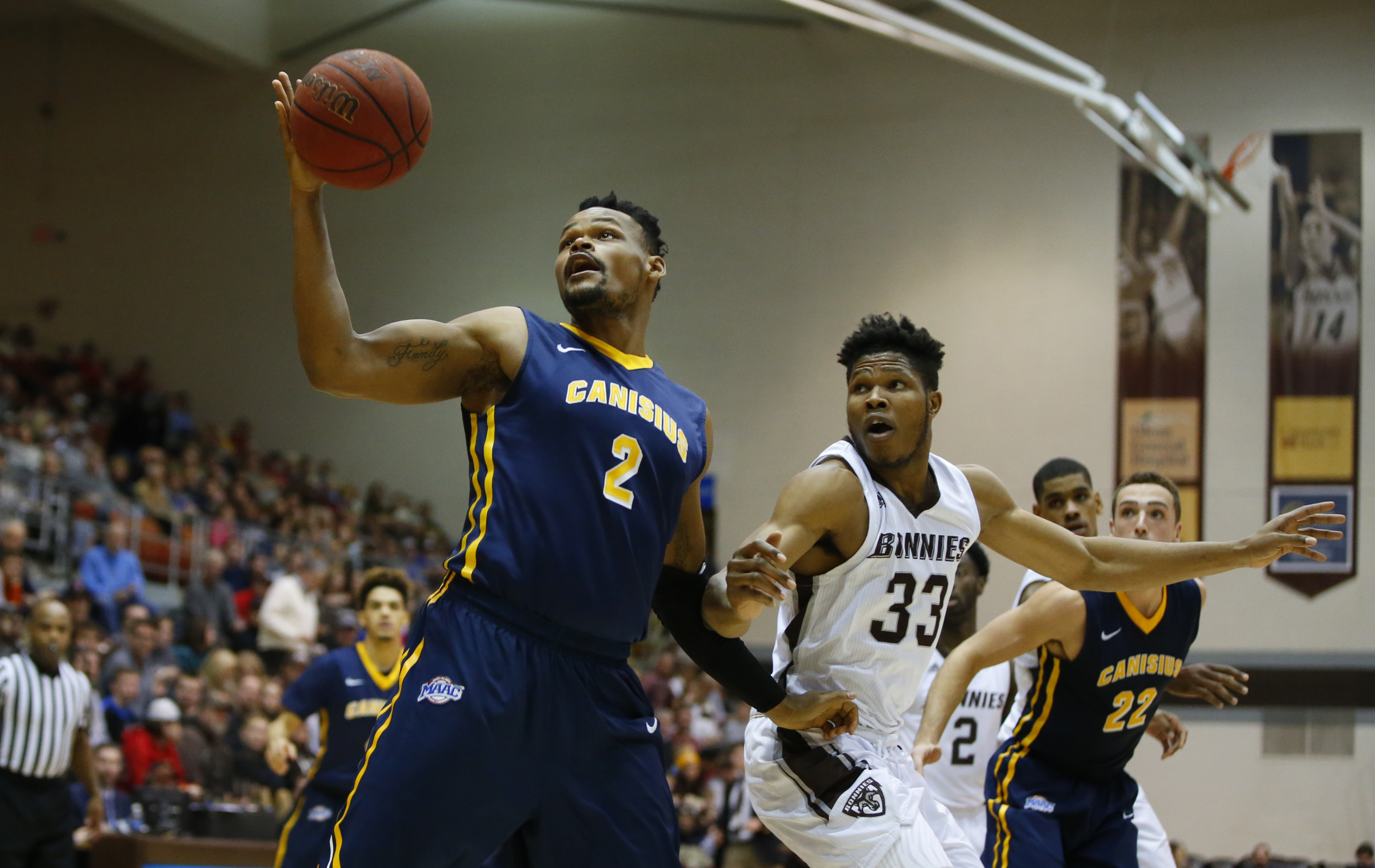 Jermain Crumpton from Canisius grabs the ball from St. Bonaventure's Josh Ayeni during second half action at the Reilly Center on Thursday, Dec. 22, 2016. (Harry Scull Jr./Buffalo News)