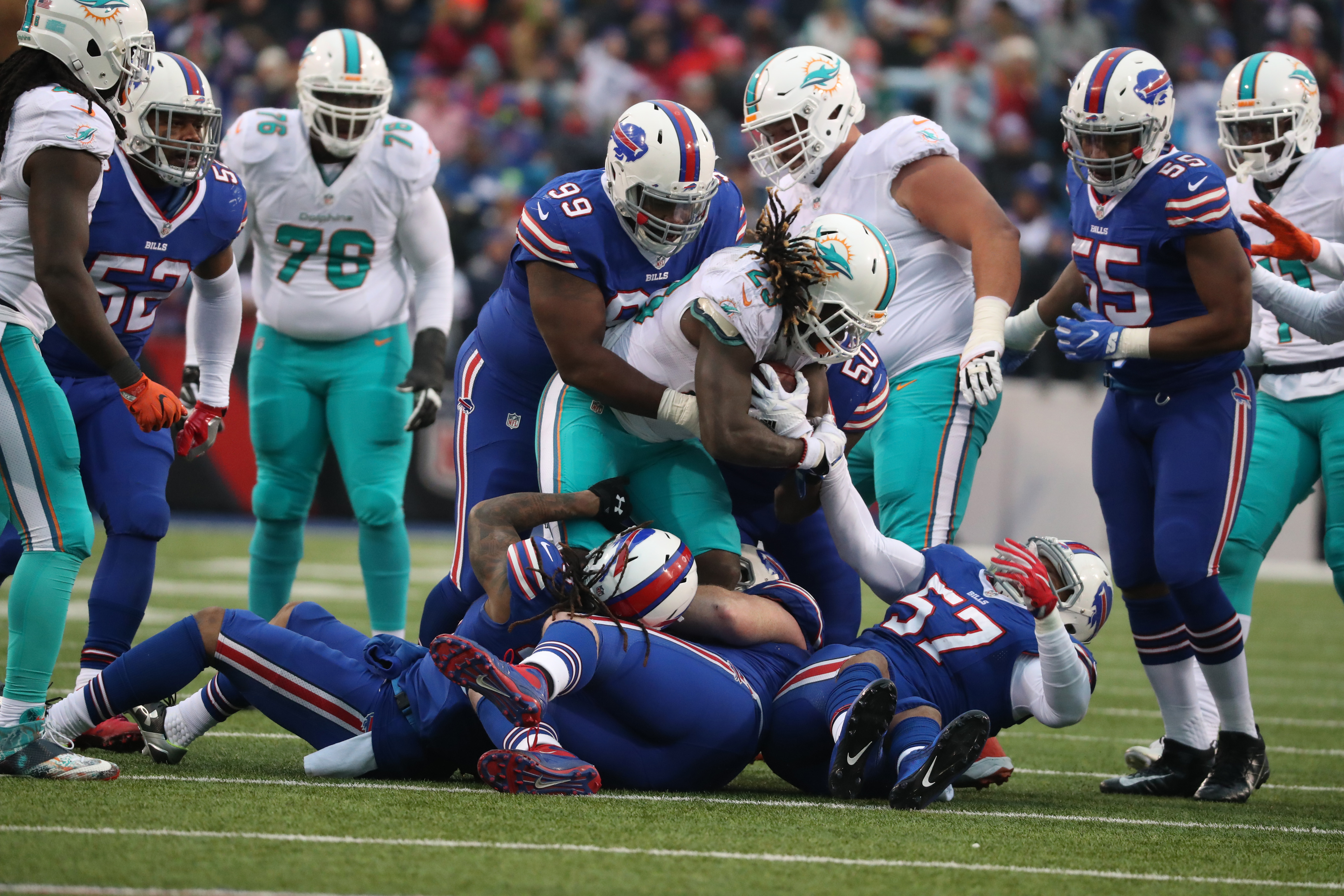 Miami Dolphins running back Jay Ajayi (23) rushes for a first down in the third quarter.  (James P. McCoy/Buffalo News)