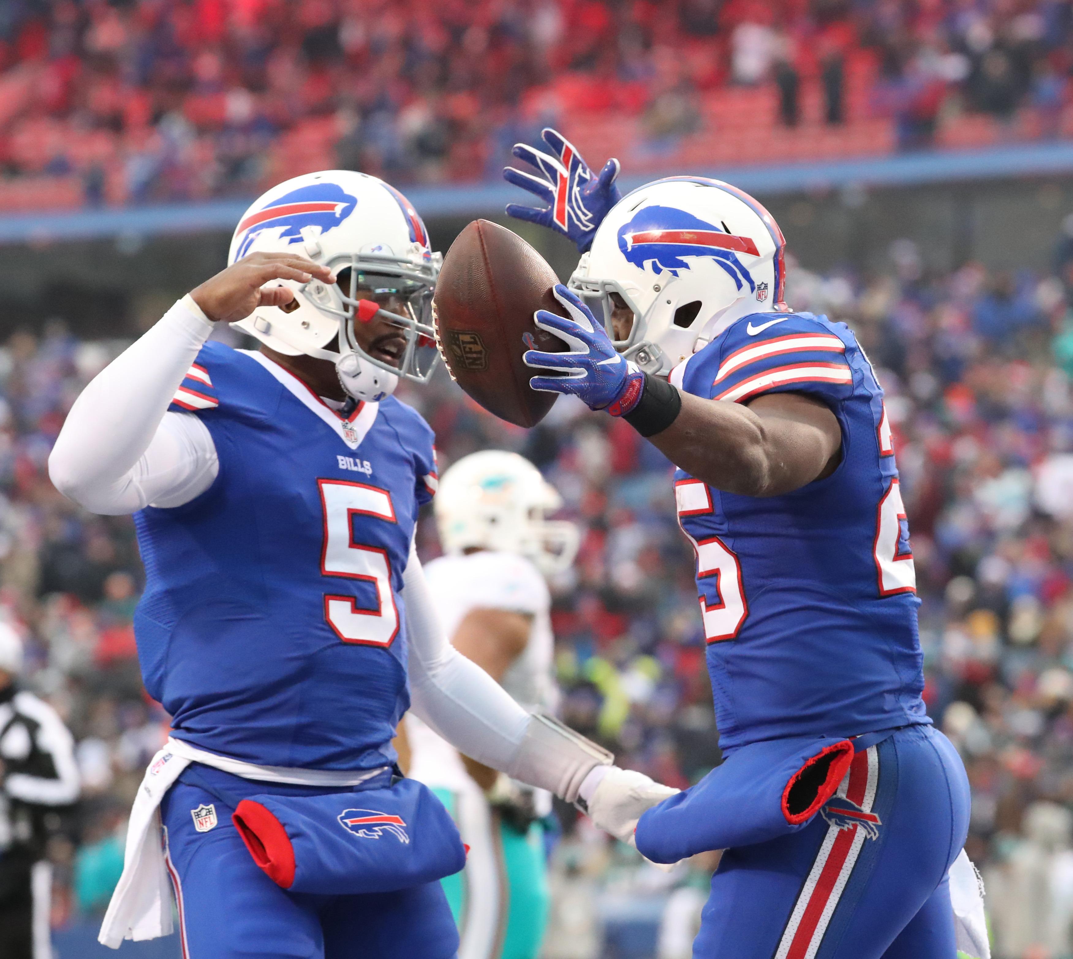 LeSean McCoy (right) celebrates a touchdown with Tyrod Taylor. (James P. McCoy/Buffalo News)