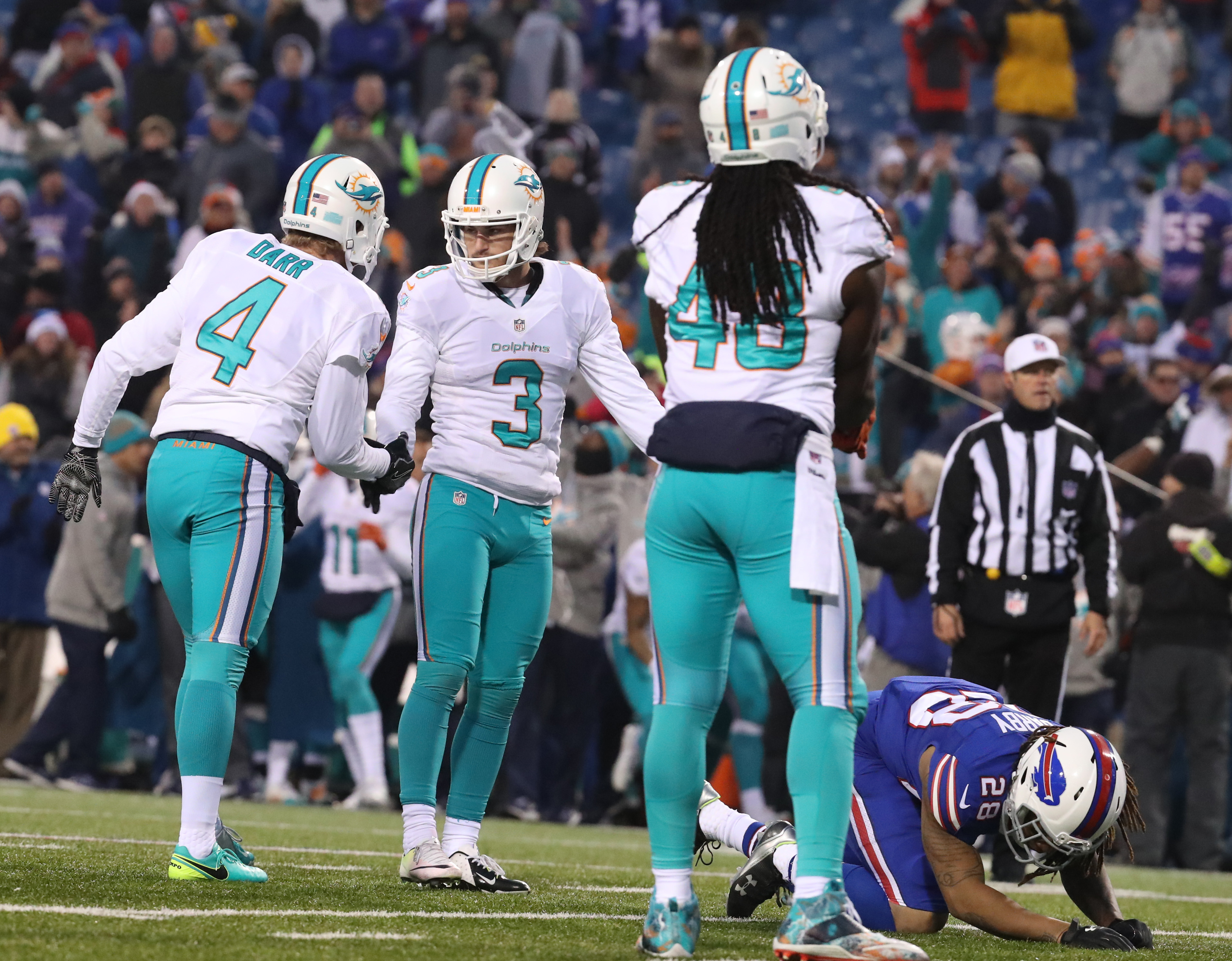 Miami Dolphins kicker Andrew Franks (3) kicks the game-winning field goal in overtime. On his game-tying kick in the fourth quarter, the Bills attempted to call a timeout but were not granted one.  (James P. McCoy/Buffalo News)