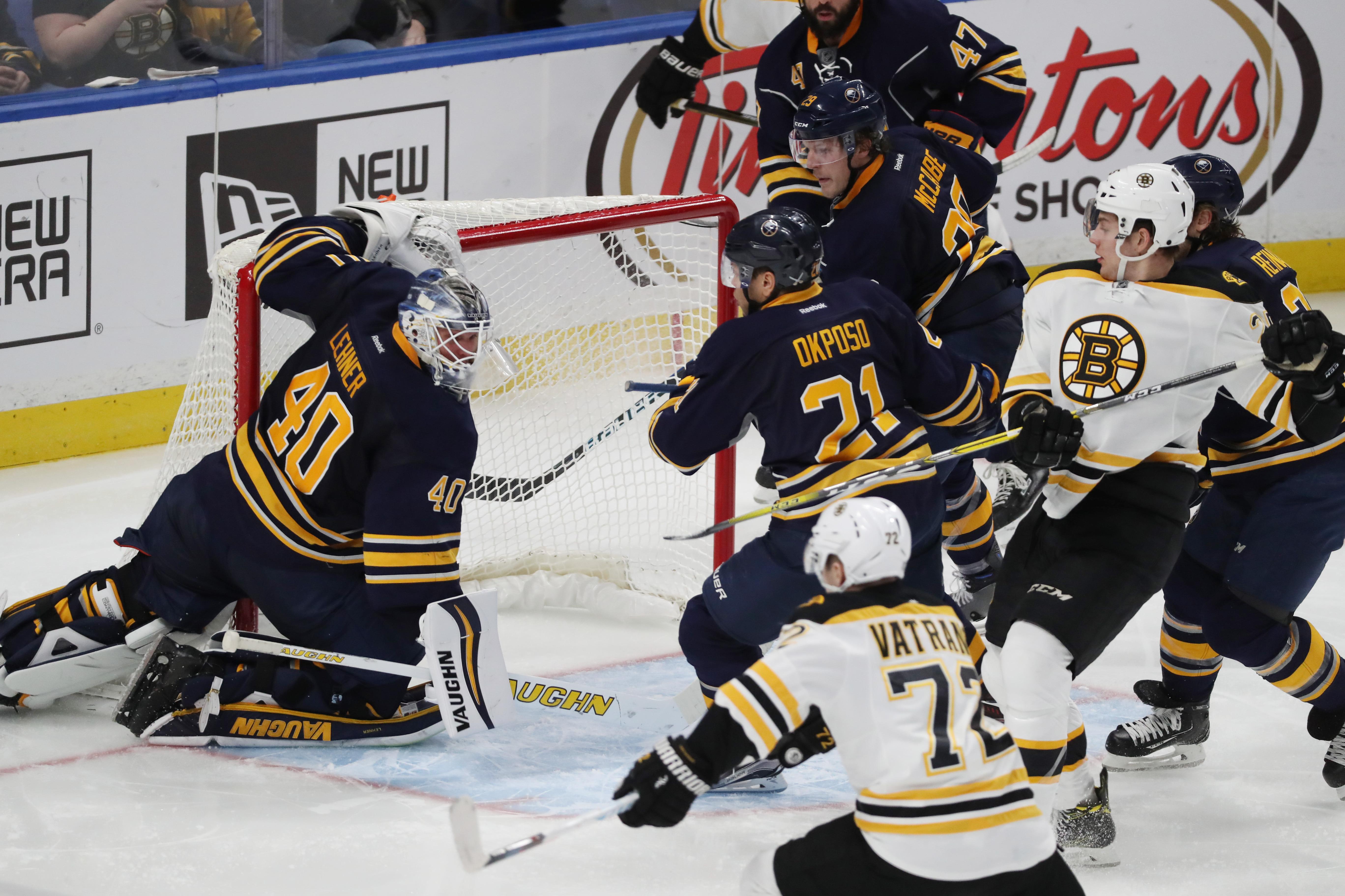 Robin Lehner makes a save against Boston's Frank Vatrano (James P. McCoy/Buffalo News).