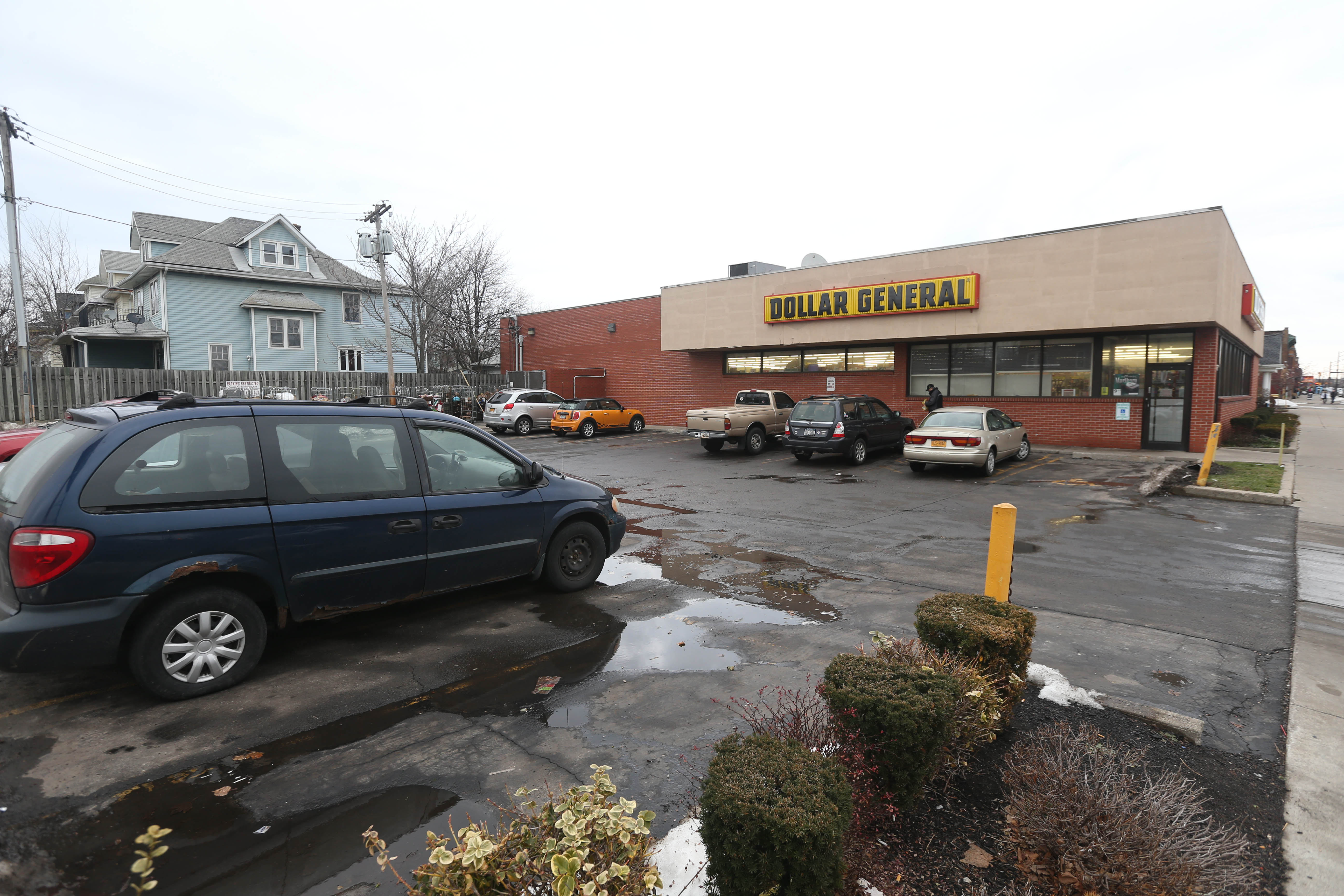 This suburban-style parking lot in front of a Dollar General on Hertel Avenue would not be allowed under the city's new Green Code. (Sharon Cantillon/Buffalo News)