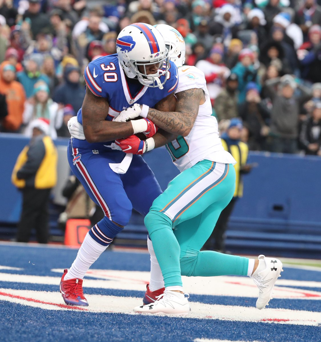 Corey White intercepts a Matt Moore pass in the second quarter of the Bills-Dolphins game on Dec. 24, 2016 (James P. McCoy/Buffalo News)