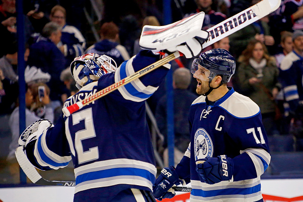 Goaltender  Sergei Bobrovsky and captain Nick Foligno celebrate the Blue Jackets' 12th straight win, Thursday's 2-1 triumph over Montreal. (Getty Images).
