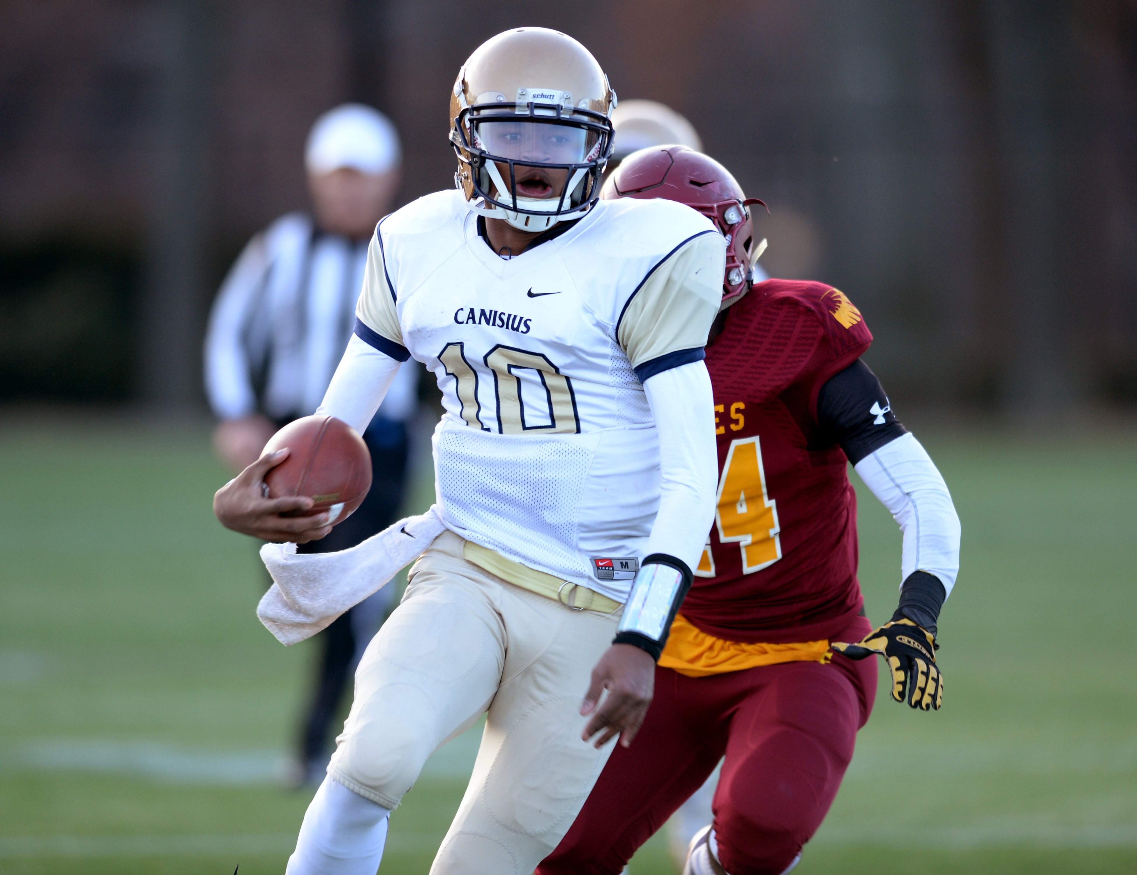 Canisius junior quarterback Jayce Johnson runs with the ball against Cardinal Hayes during the New York State Catholic High School Athletic Association championship on Sunday. (Special to The News/Damion Reid)