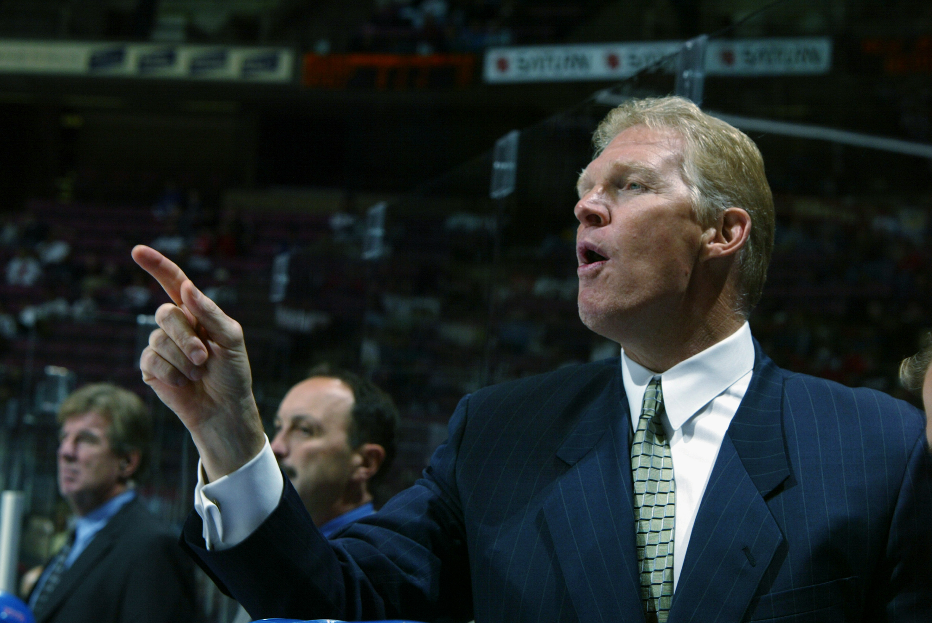 Jim Schoenfeld, shown as assistant coach of the Rangers in 2002, had a famous fight 44 years ago Tuesday. (Getty Images)