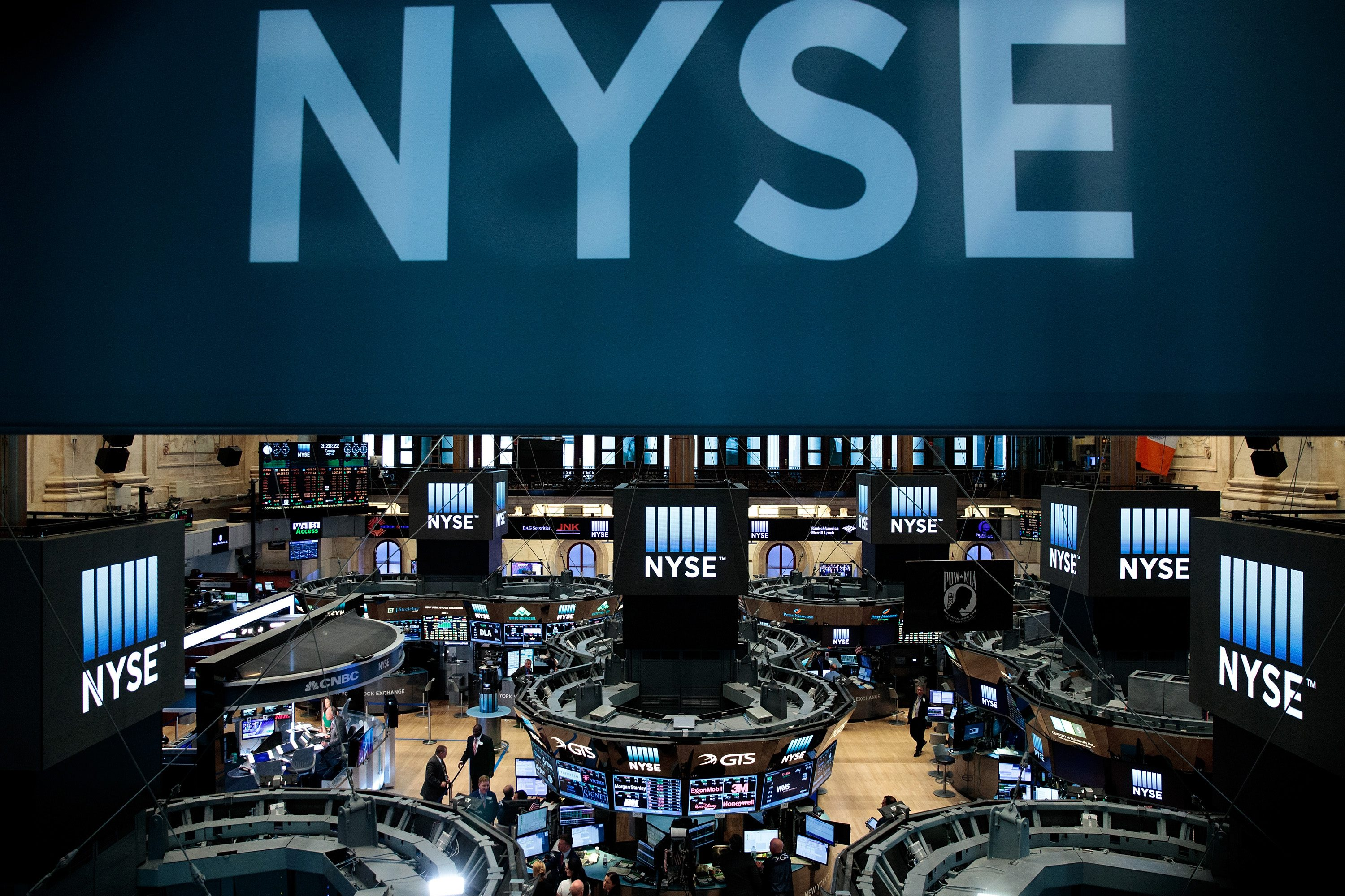 Traders and financial professionals work on the floor of the New York Stock Exchange. (Drew Angerer/Getty Images)