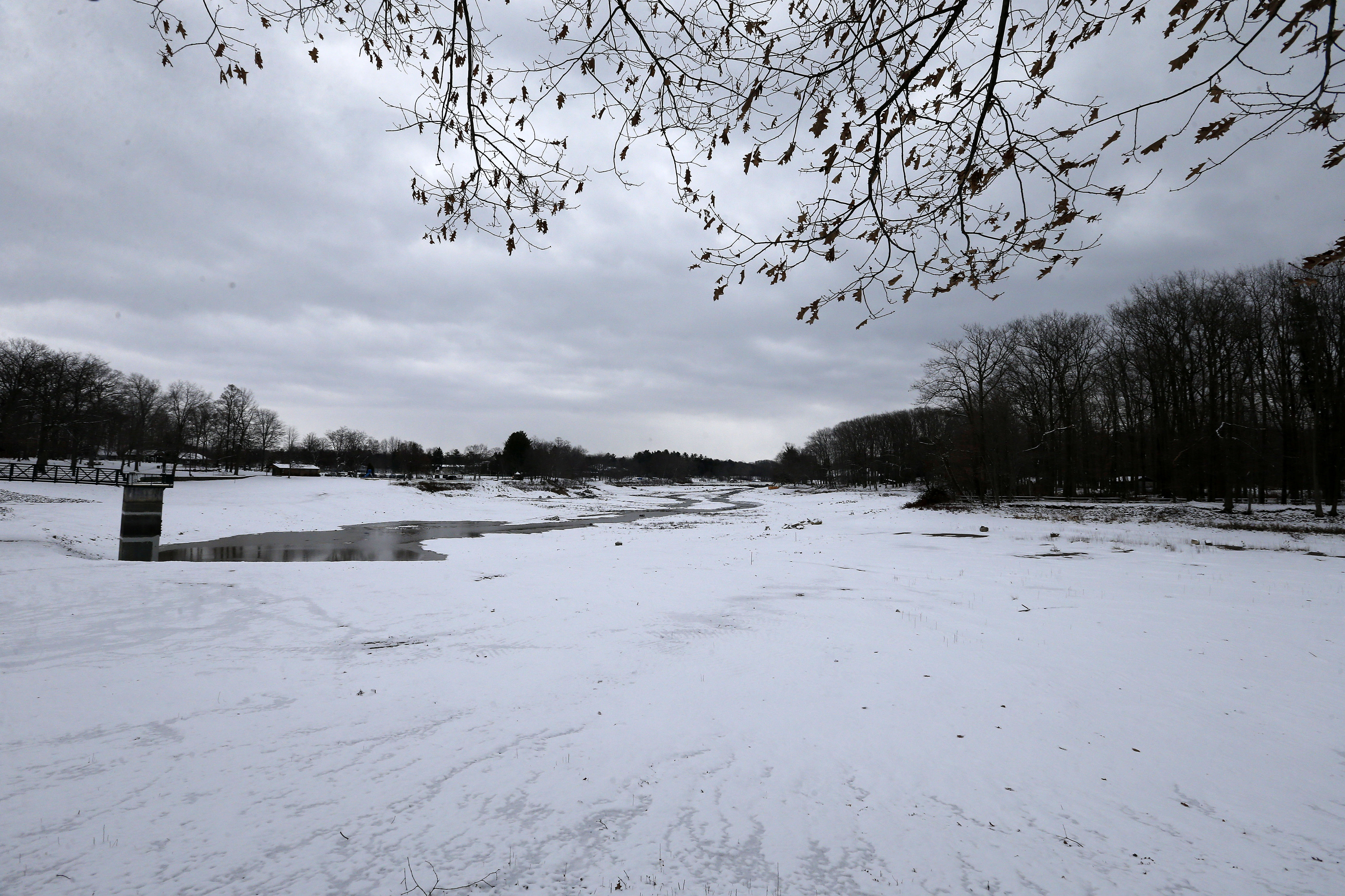 Green Lake starts to fill with water in Orchard Park on Thursday, December 8, 2016.  The lake was drained in 2015 and dredged in 2016. while a new dam was constructed. Town officials closed the lower dam gate on Dec. 8 so the lake could fill with rainwater and snow. (Mark Mulville/The Buffalo News)