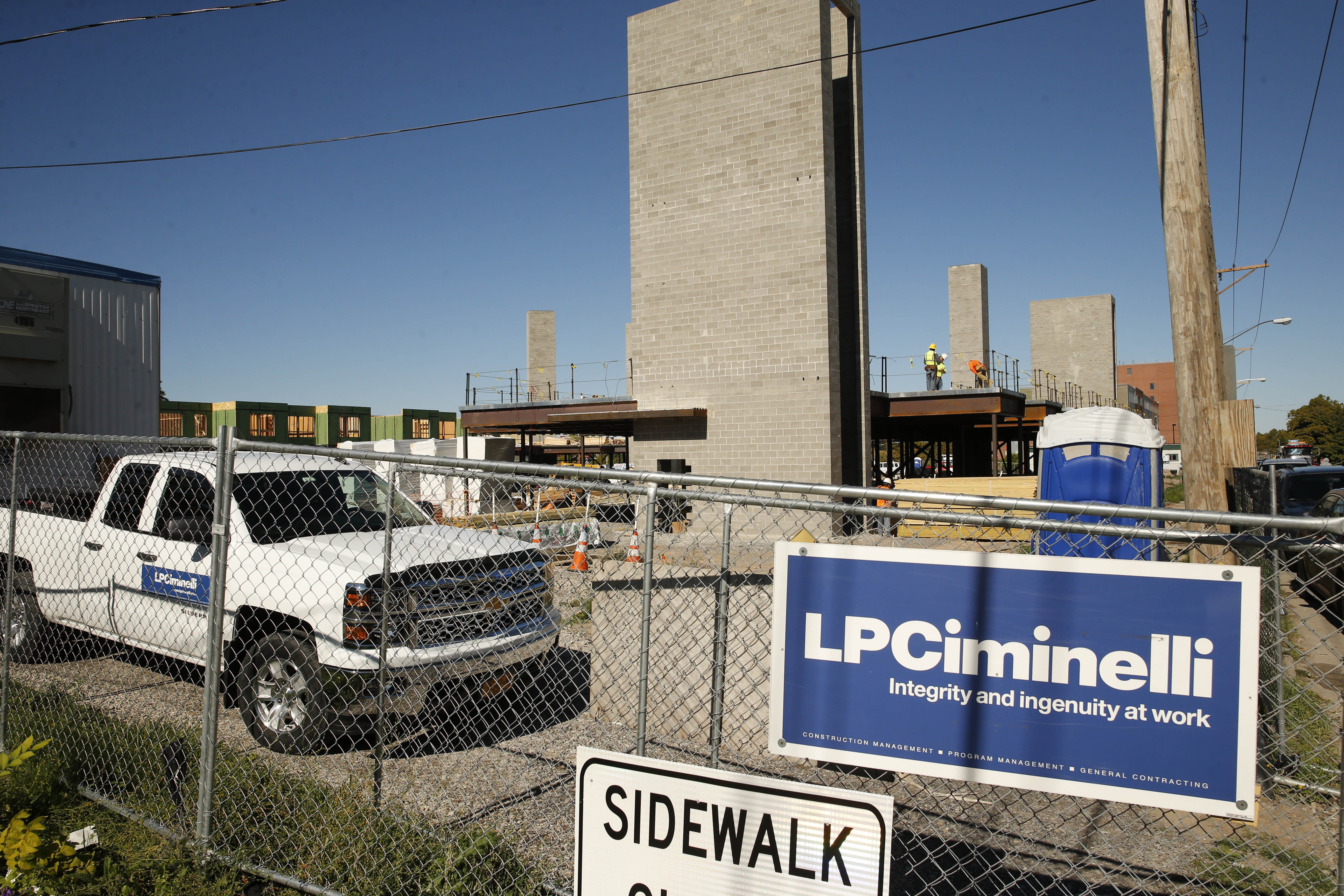 A sign touts LPCiminelli at a construction work site on Grant Street. The federal indictment of Louis P. Ciminelli and two of his deputies puts the company under new public scrutiny.