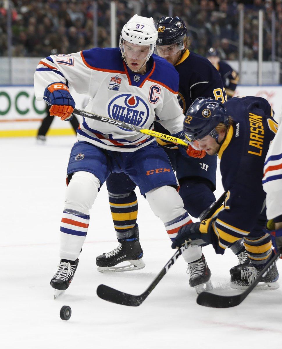 Connor McDavid battles Johan Larsson Tuesday in KeyBank Center (Harry Scull Jr./Buffalo News).