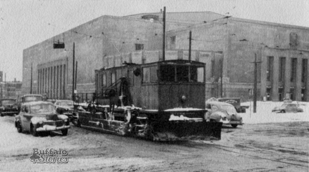 A streetcar adapted to plow snow clears a path in front of Memorial Auditorium, some time in the 1940's. Buffalo Stories archives