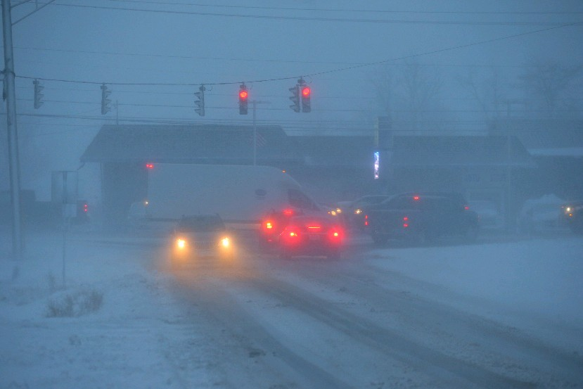 Traffic blowing snow, poor visibility and slick roads on commute on Fisk Road near Transit Road in Pendleton on Thursday. (John Hickey/Buffalo News)