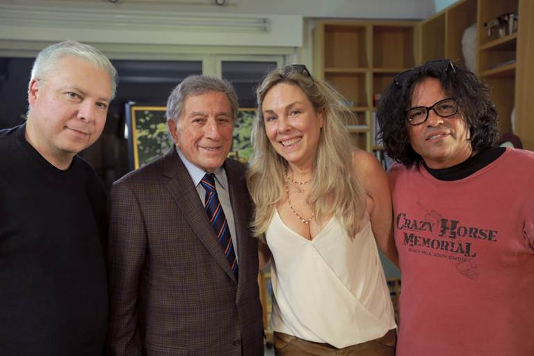 """Three executives of the new film """"RUMBLE: The Indians who Rocked the World,"""" pose with Tony Bennett after interviewing him. They are, from left, Tim Johnson, executive producer; Bennett; Catherine Bainbridge, director; and Stevie Salas, executive producer."""