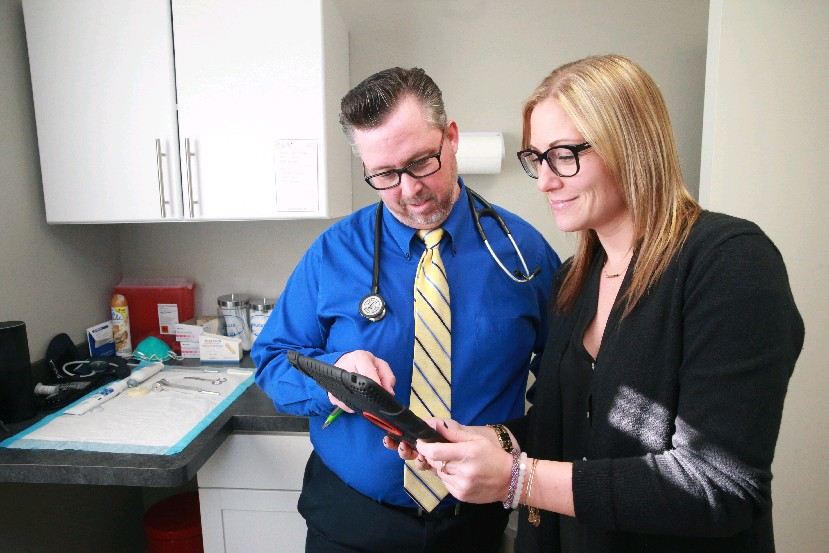 ":""As nurse practitioners, we're first trained as nurses. Nursing is a caring science and I think that's why nurse practitioners generally have a good reputation."" Charles W. Burns, left, a nurse practitioner and owner of Destination Wellness in Orchard Park, with office manager and stepdaughter Katie Rowley. (John Hickey/Buffalo News)"
