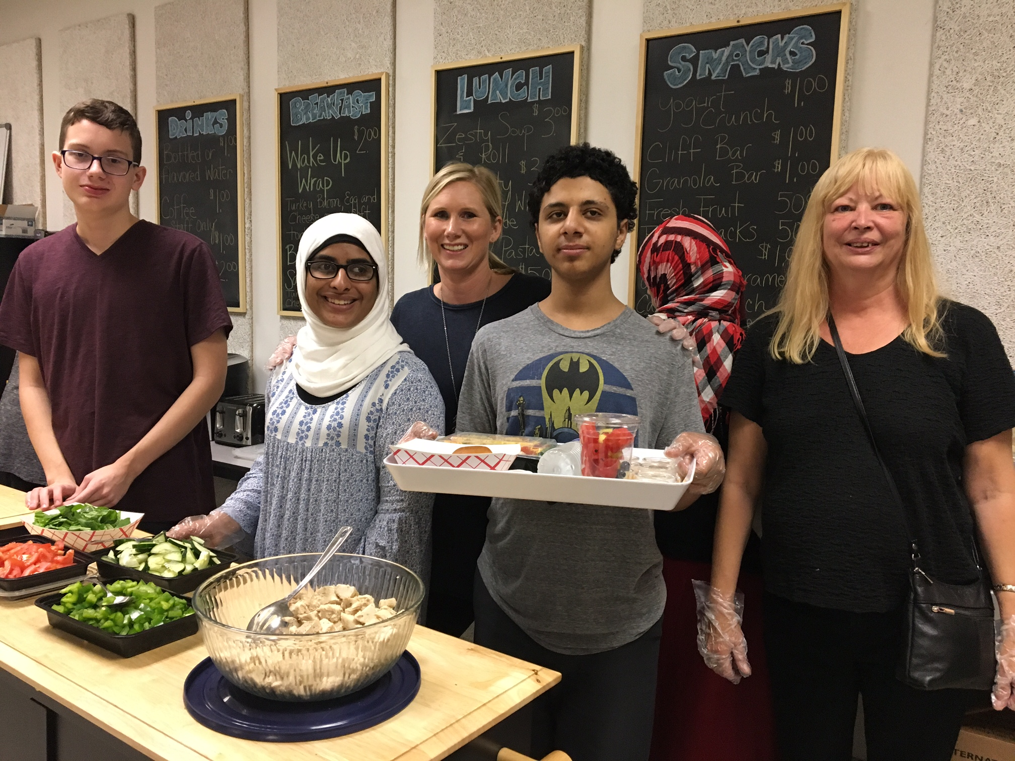 The Lunch Box staff and advisors include, from left, Christopher Stevens, 15, a sophomore; Anhar Muflahi, 16, a junior; life skills teacher Jen Willats; Abdullah Yossif, 16, a sophomore; and Sue Motyka, a teacher aide for the class.
