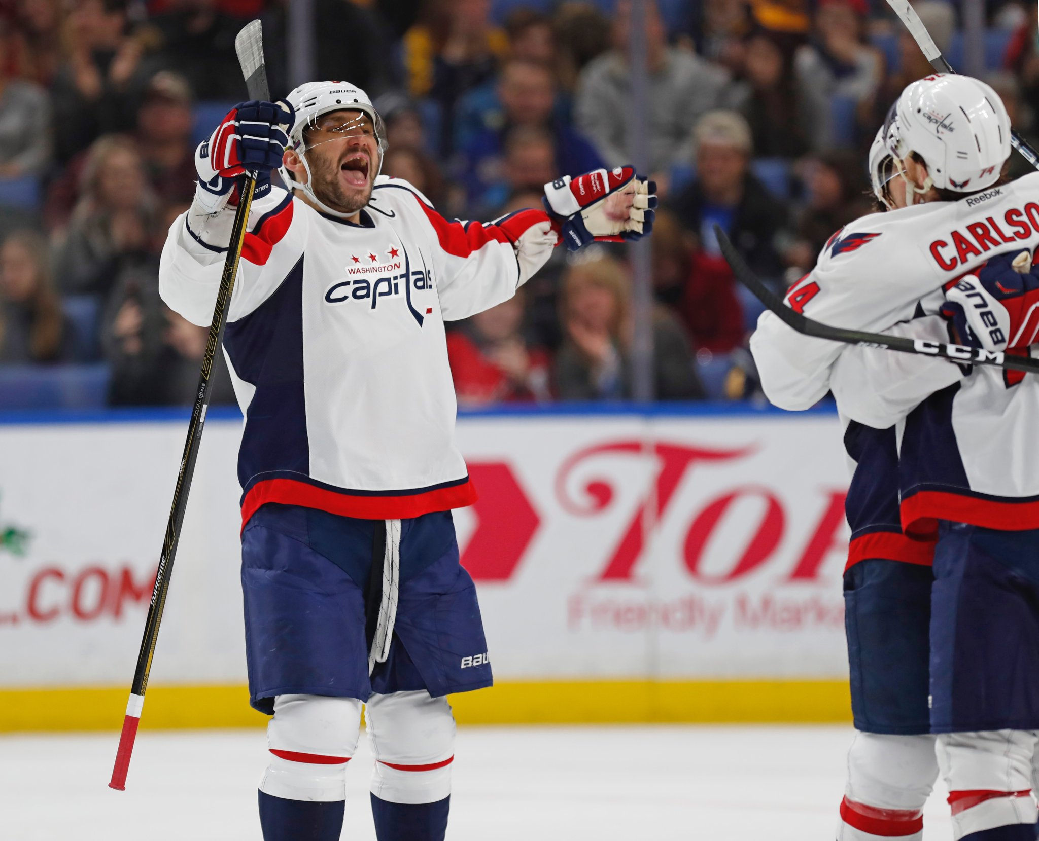 Alex Ovechkin celebrates the Capitals' second power-play goal, scored by John Carlson. (Harry Scull Jr./Buffalo News)