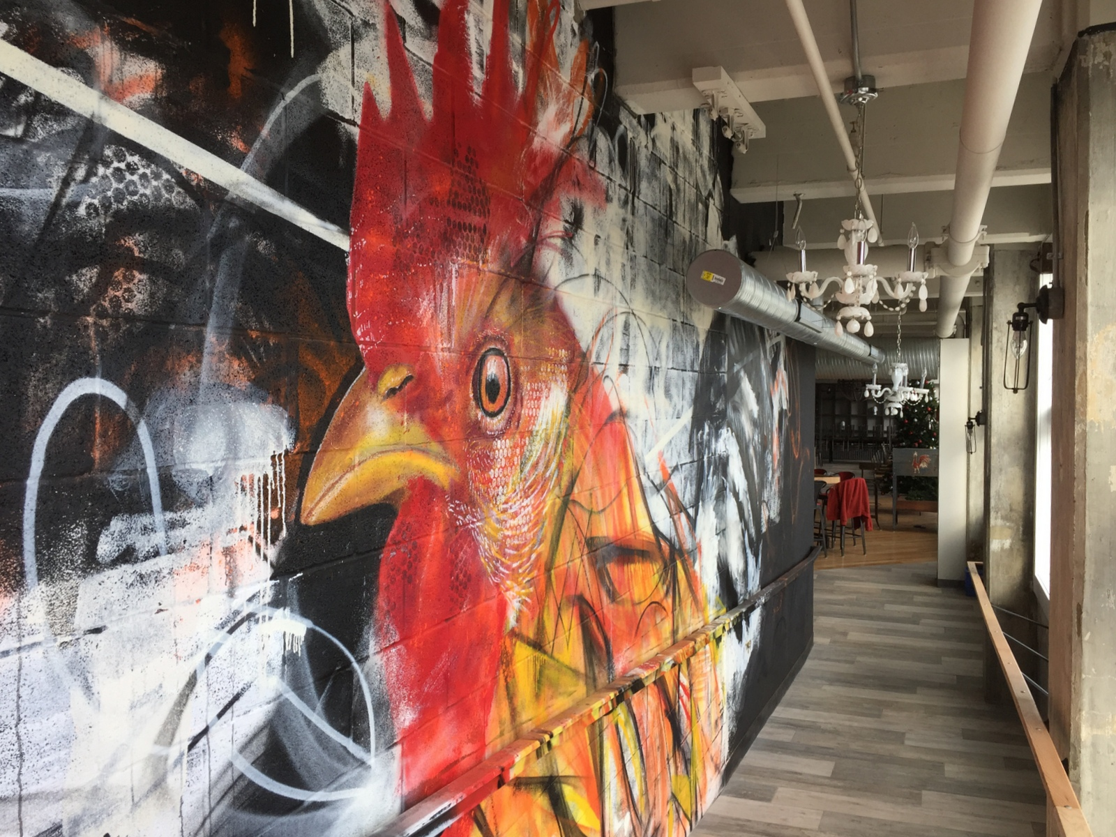 Mural of a rooster adorns an entryway at Roost. (Andrew Galarneau/Buffalo News)