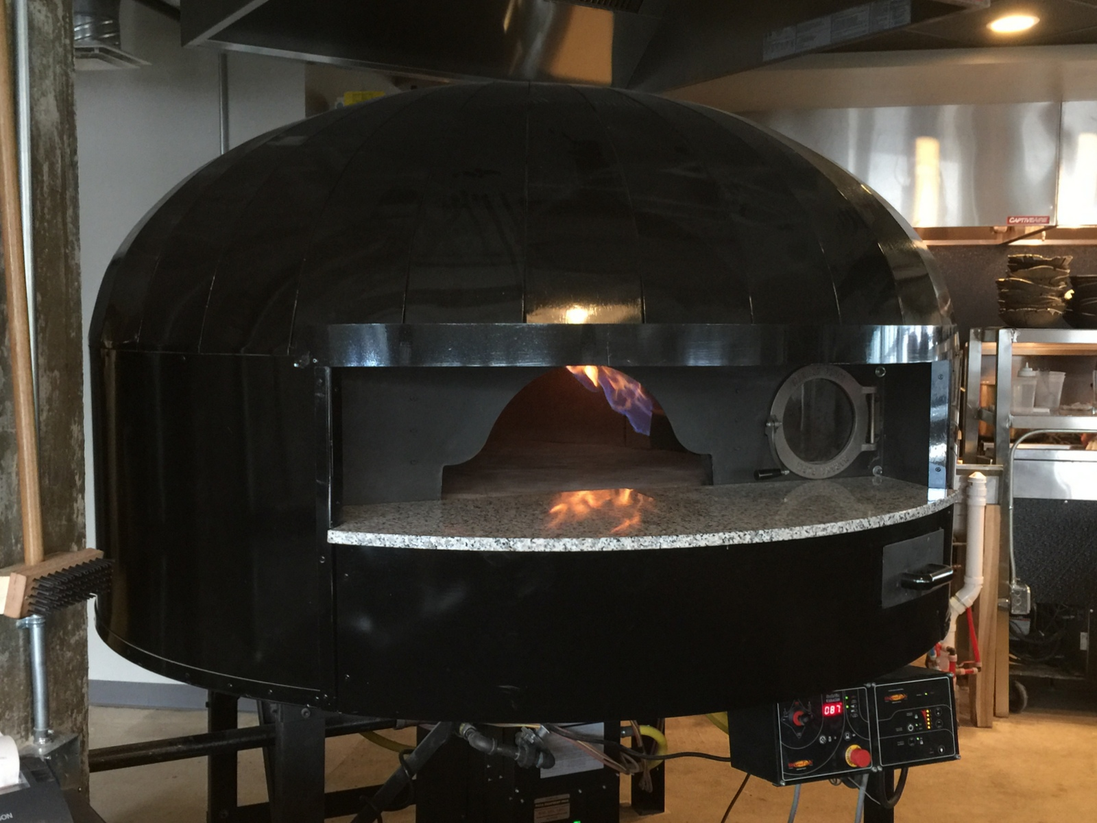 The 8,000-pound rotating-deck pizza oven at Roost. (Andrew Galarneau/Buffalo News)
