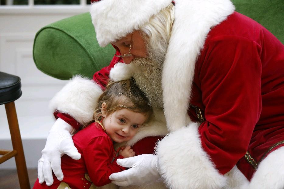 Santa is among those who understands that hugs are healthier than handshakes. (Mark Mulville/Buffalo News)