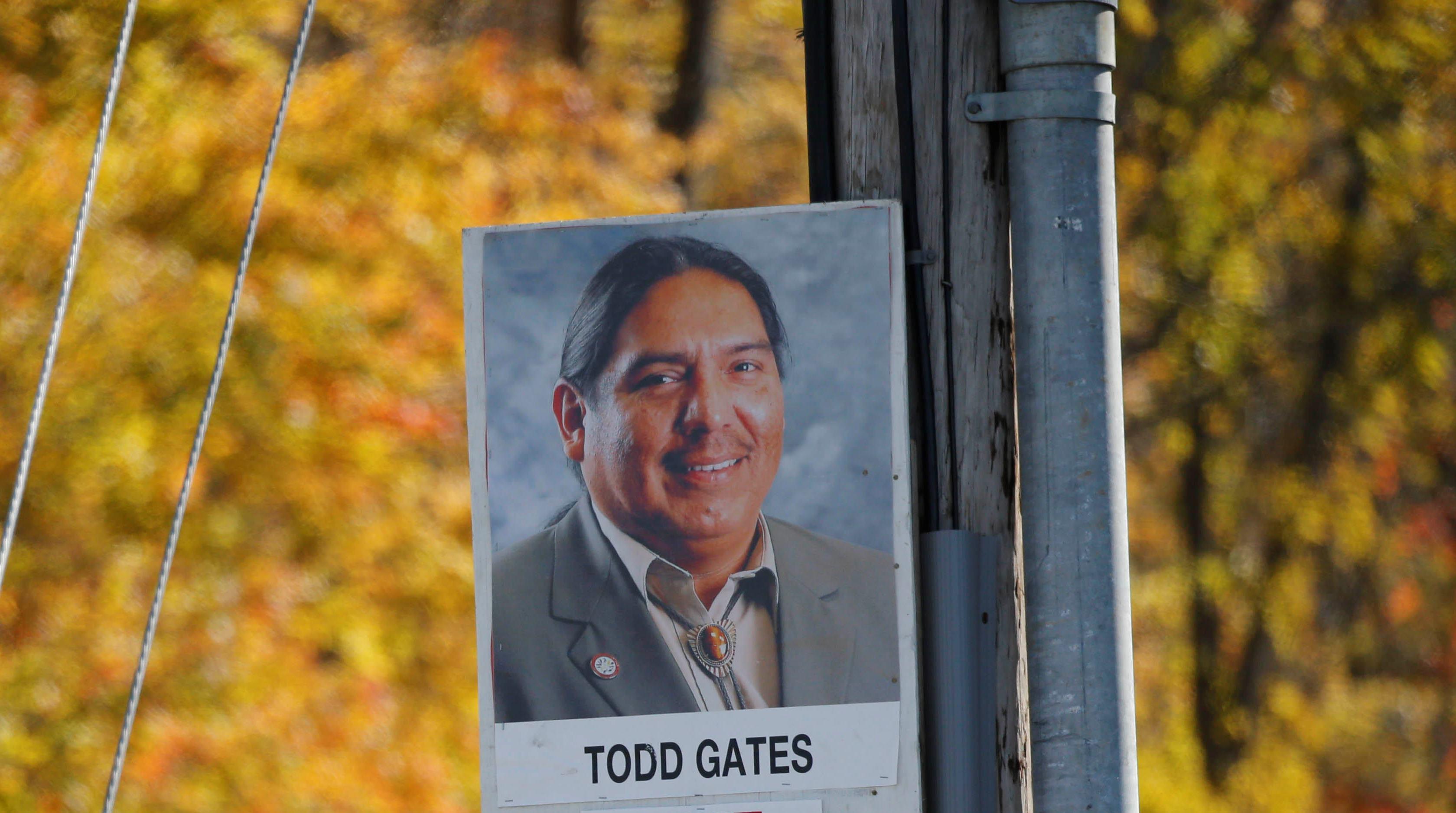 A sign hangs on a lamp pole for Seneca Nation President Todd Gates.  (Derek Gee/Buffalo News)