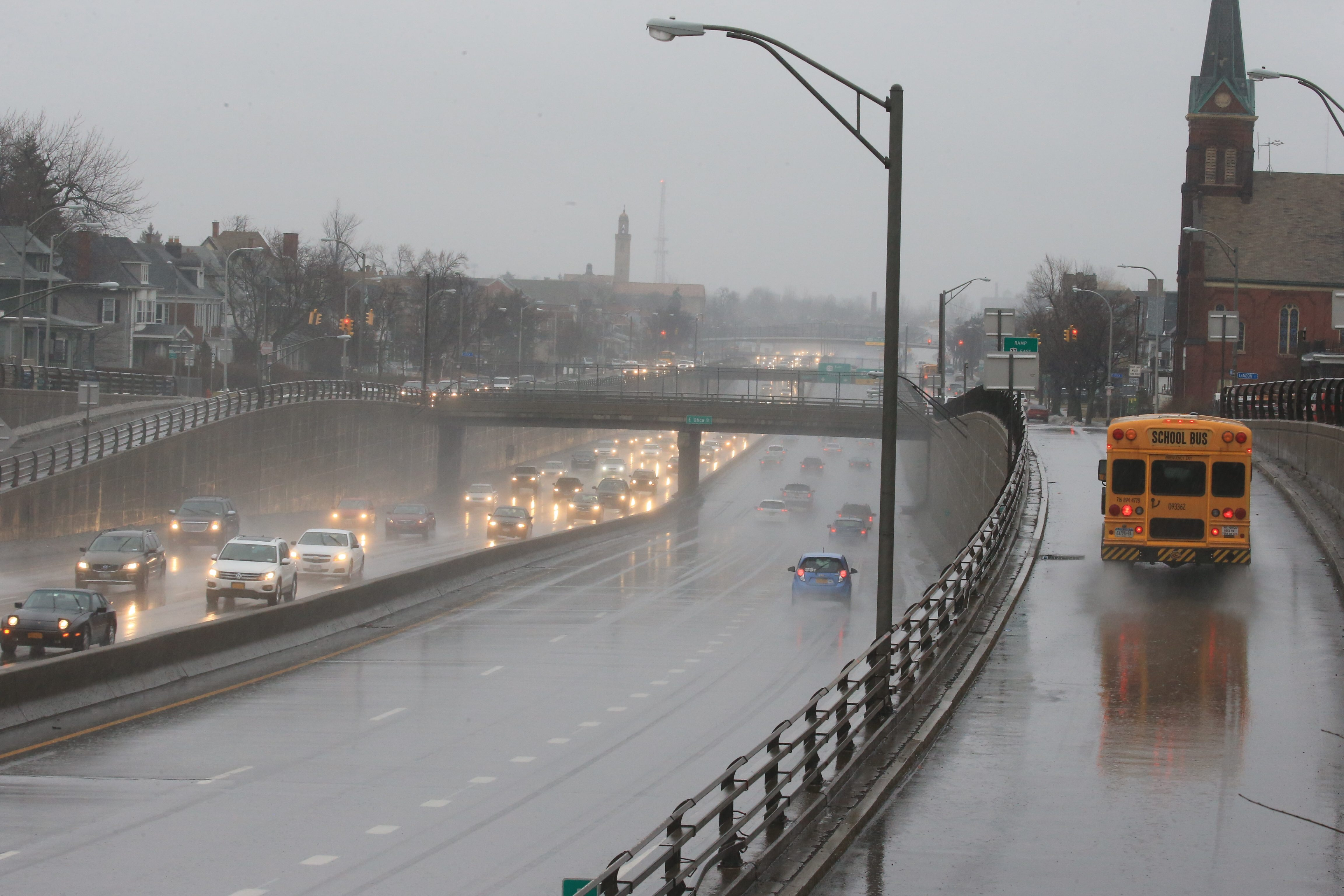 Commuters drive into the city on Route 33, in Buffalo, on  Wednesday Feb. 24, 2016, under a steady rain. Freezing rain had been forecast for later in the day. (John Hickey/Buffalo News)