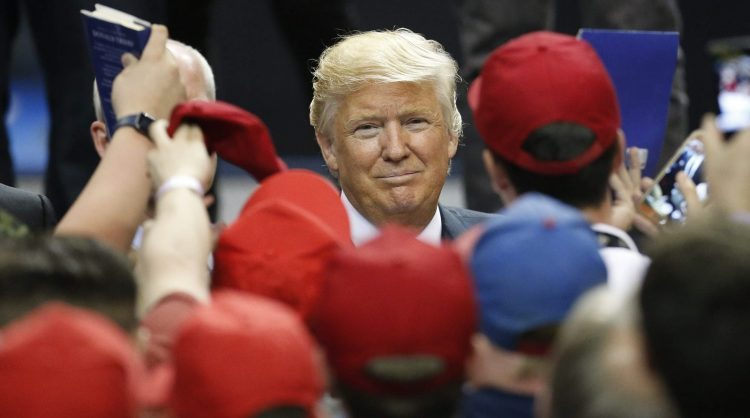 Donald Trump greets supporters after his speech during a rally at First Niagara Center in Buffalo on April 18, 2016.  (Derek Gee/Buffalo News)