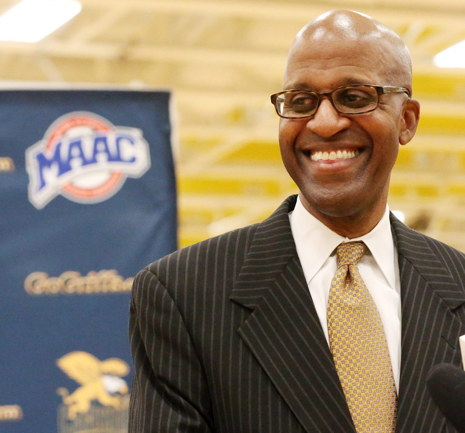 Canisius' Reggie Witherspoon smiles while being introduced as the new head basketball coach during a press conference at Koessler Athletic Center  on Tuesday, May 31, 2016.  (James P. McCoy/Buffalo News)
