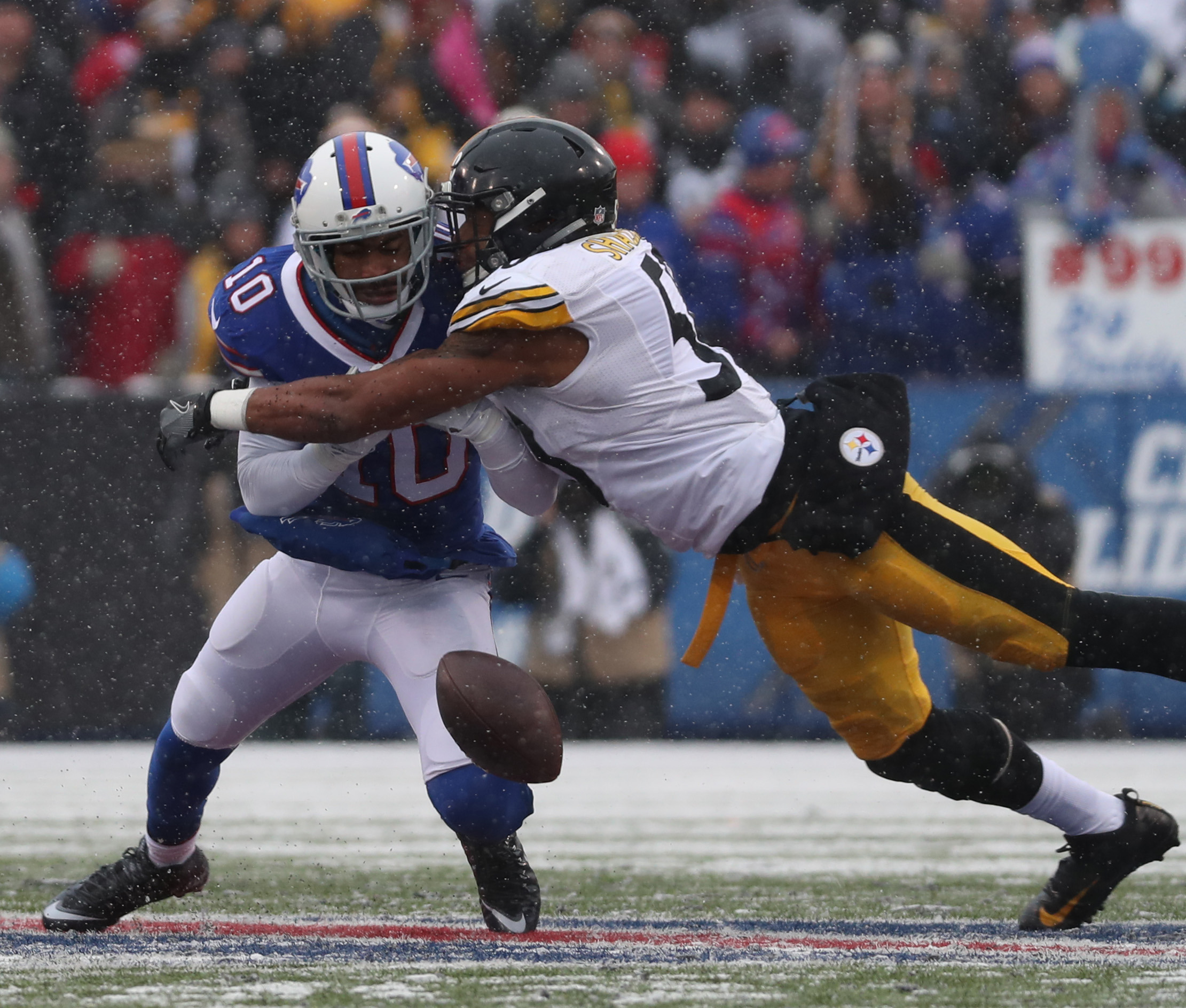 Robert Woods (10) drops the ball while covered by Pittsburgh Steelers linebacker Ryan Shazier in the Dec. 11 game at New Era Field. (James P. McCoy/Buffalo News)