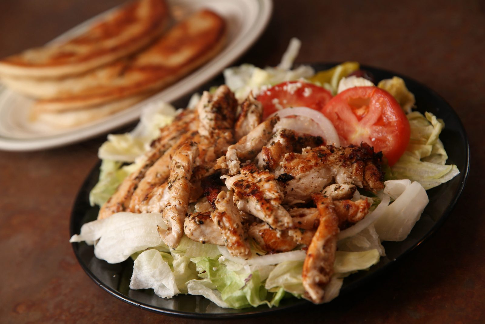 Open chicken souvlaki at Nick's Place, a neighborhood favorite in Black Rock, will be the model for the version offered at Nick's Place Express in Kenmore. (Sharon Cantillon/Buffalo News)