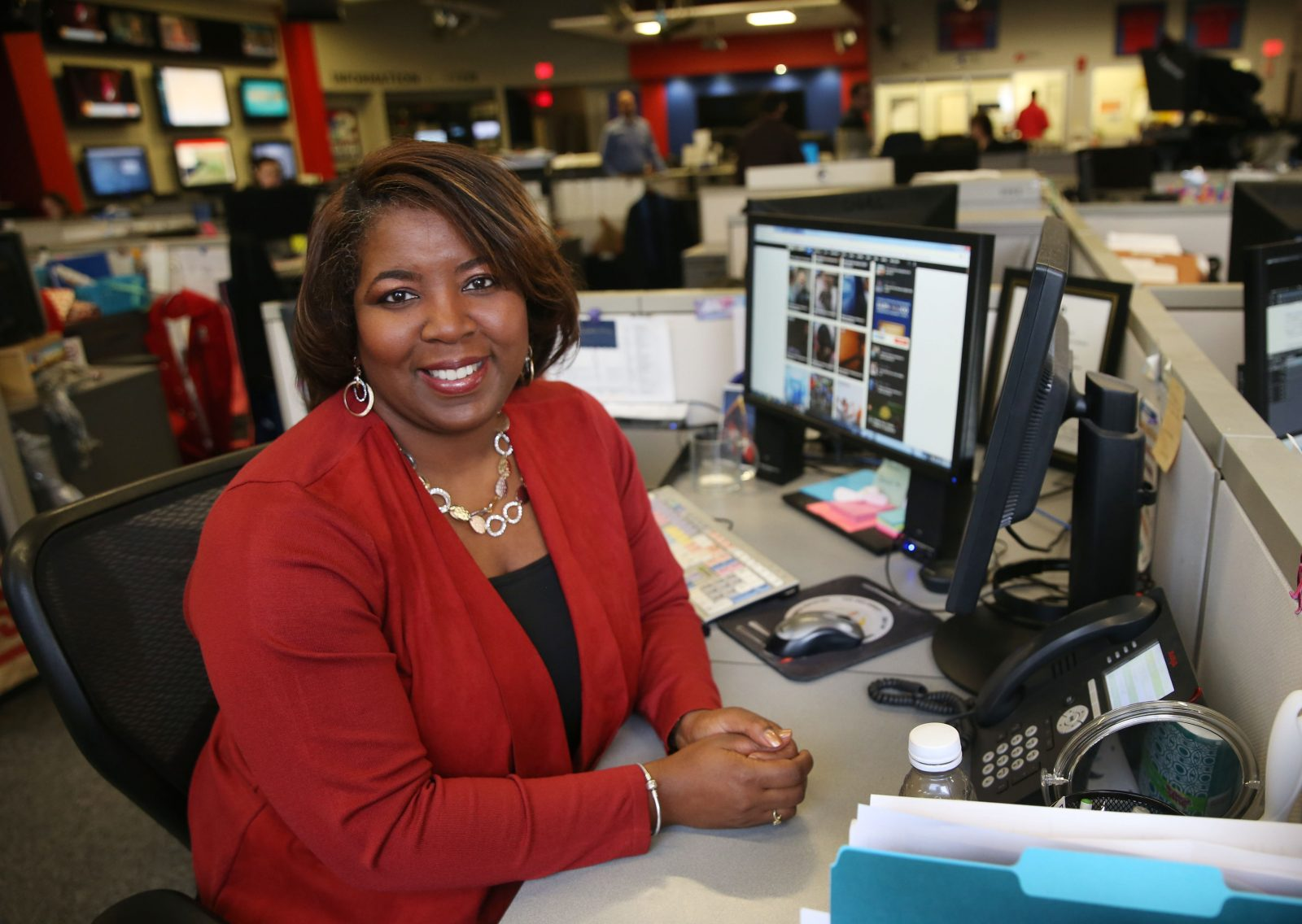 Claudine Ewing, here at her desk at WGRZ, has been a Buffalo braodcaster for 25 years.  (Sharon Cantillon/Buffalo News)