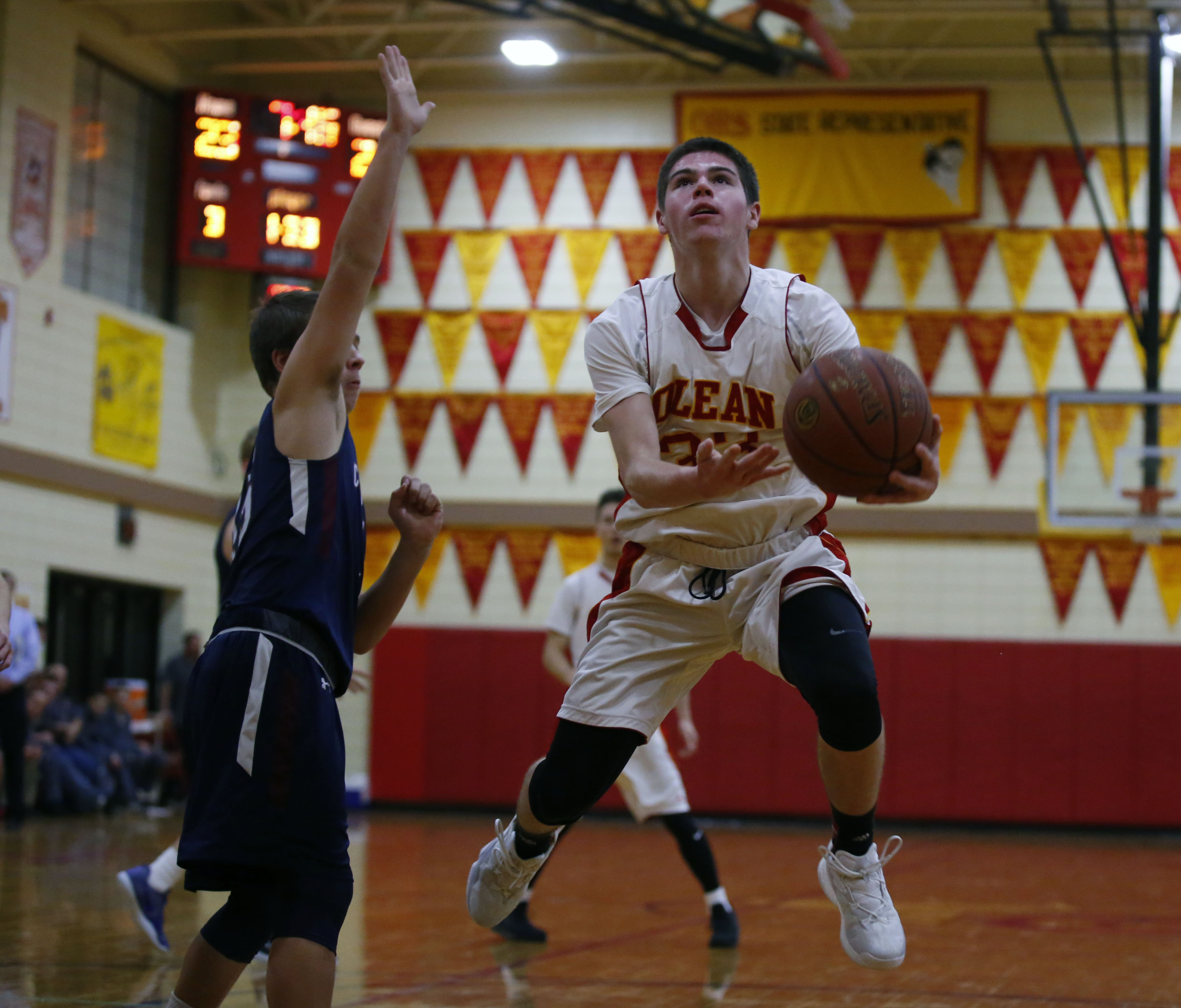 Olean's Mike Schmidt (right) and the Huskies are ranked in the top 10 among large schools in boys' baskeball. (Harry Scull Jr./Buffalo News)