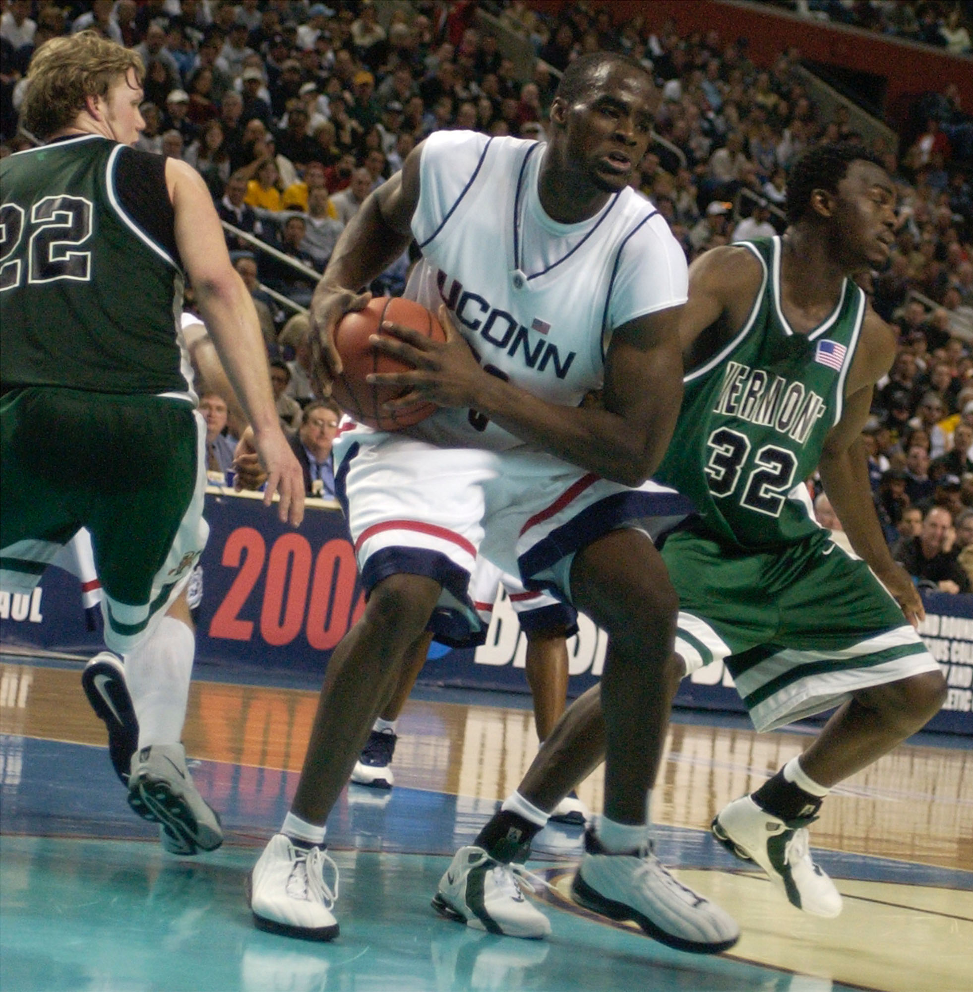 UConn 's  Emeka Okafore protects a rebound as  University of Vermont  players fall back. (John Hickey/Buffalo News)