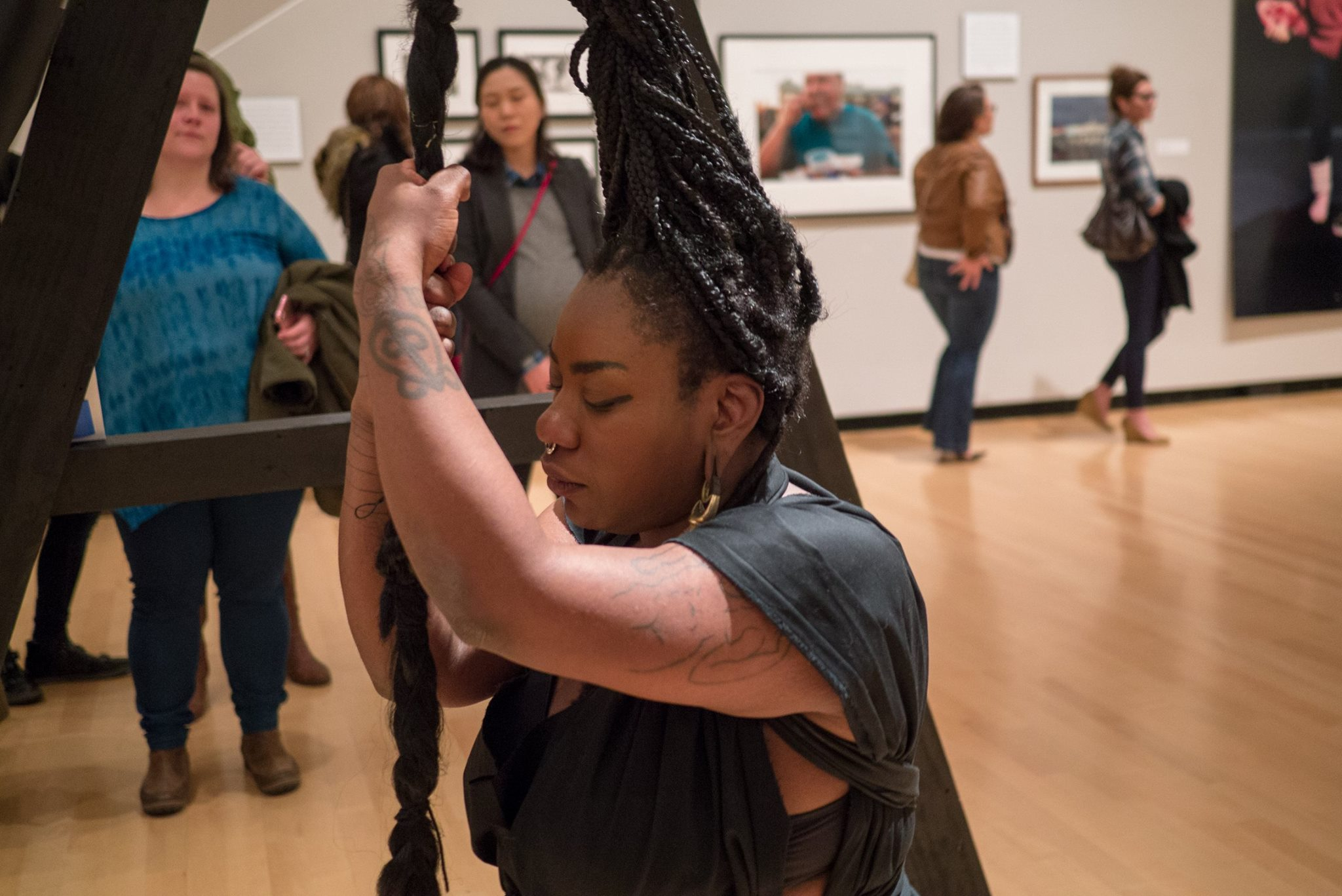 Dana McKnight performed her piece 'Trussed' on Dec. 9 in the Burchfield Penney Art Center. (Photo by Derek Neuland.)