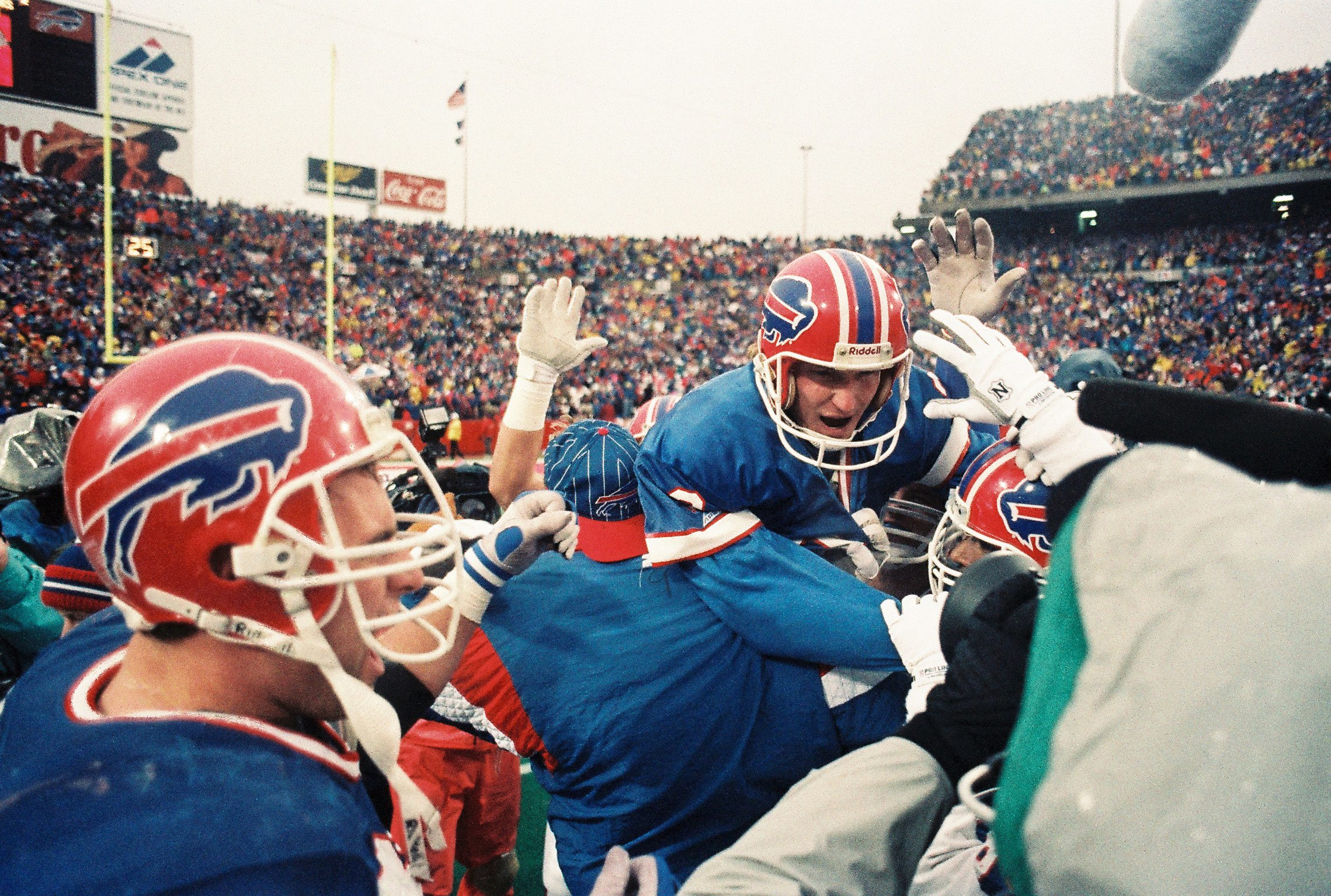 Steve Christie celebrates the game-winning field goal that capped the greatest comeback in NFL history. (James P. McCoy/News file photo)