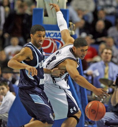 Old Dominion's Drew  Williams fouls Butler's Brain Ligon. (James P. McCoy/Buffalo News)