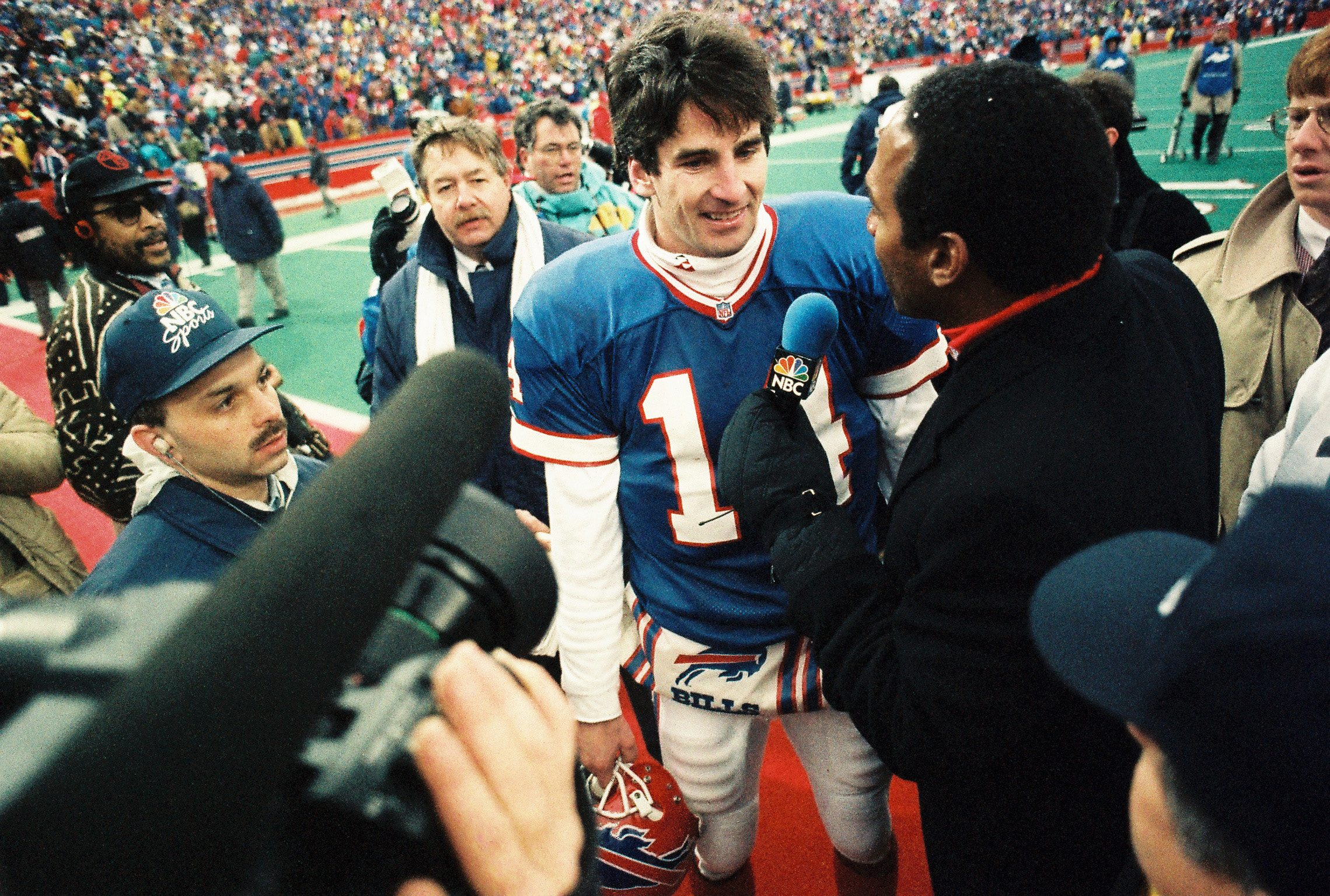 Frank Reich is interviewed by O.J. Simpson after the comeback victory against the Oilers. {Photo by James P. McCoy/Buffalo News}