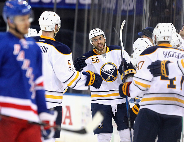 Cody Franson and Zach Bogosian are among the teammates waiting to greet Justin Bailey after his first NHL goal (Getty Images).